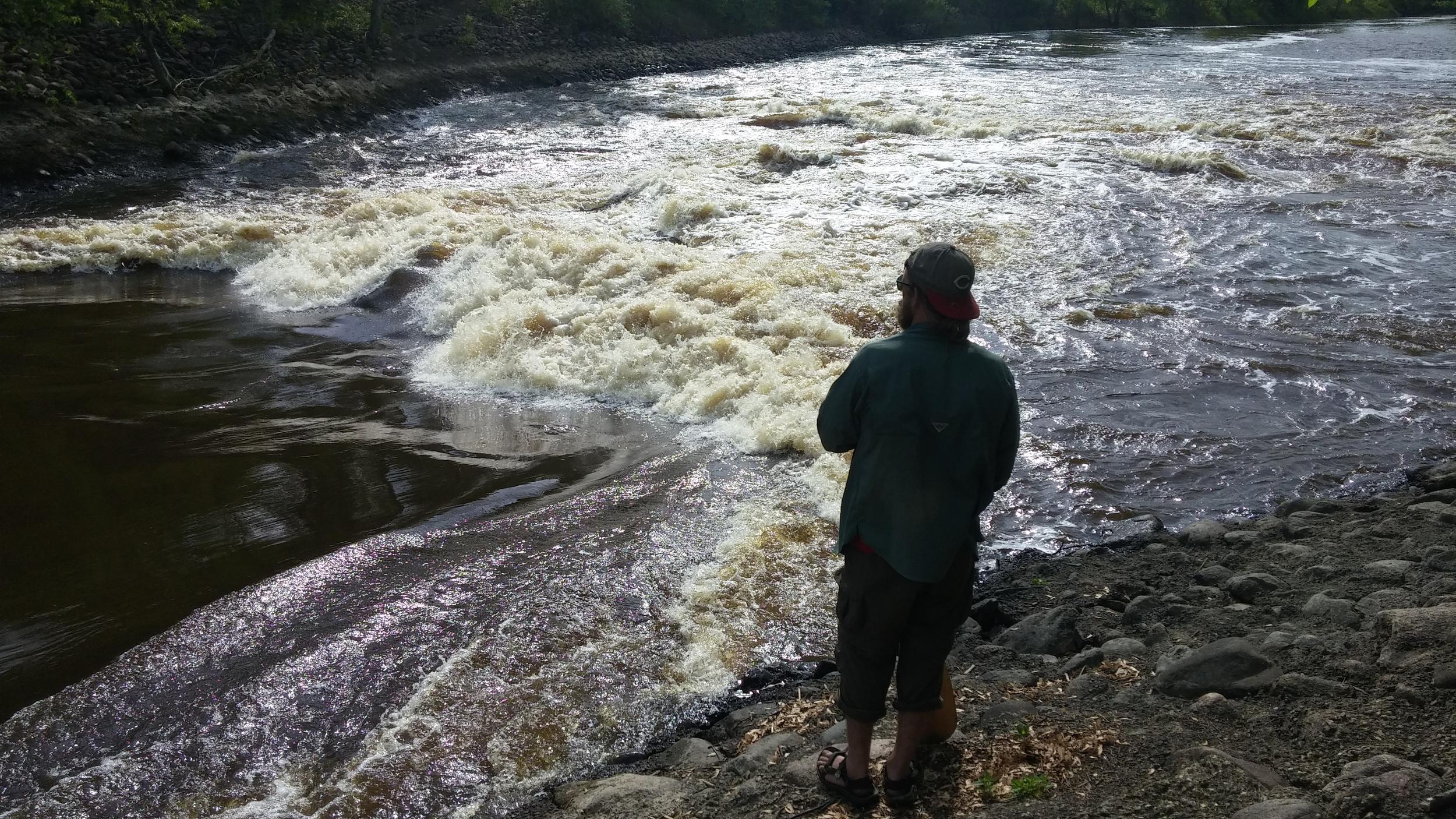 Shea surveys a treacherous stretch of river.