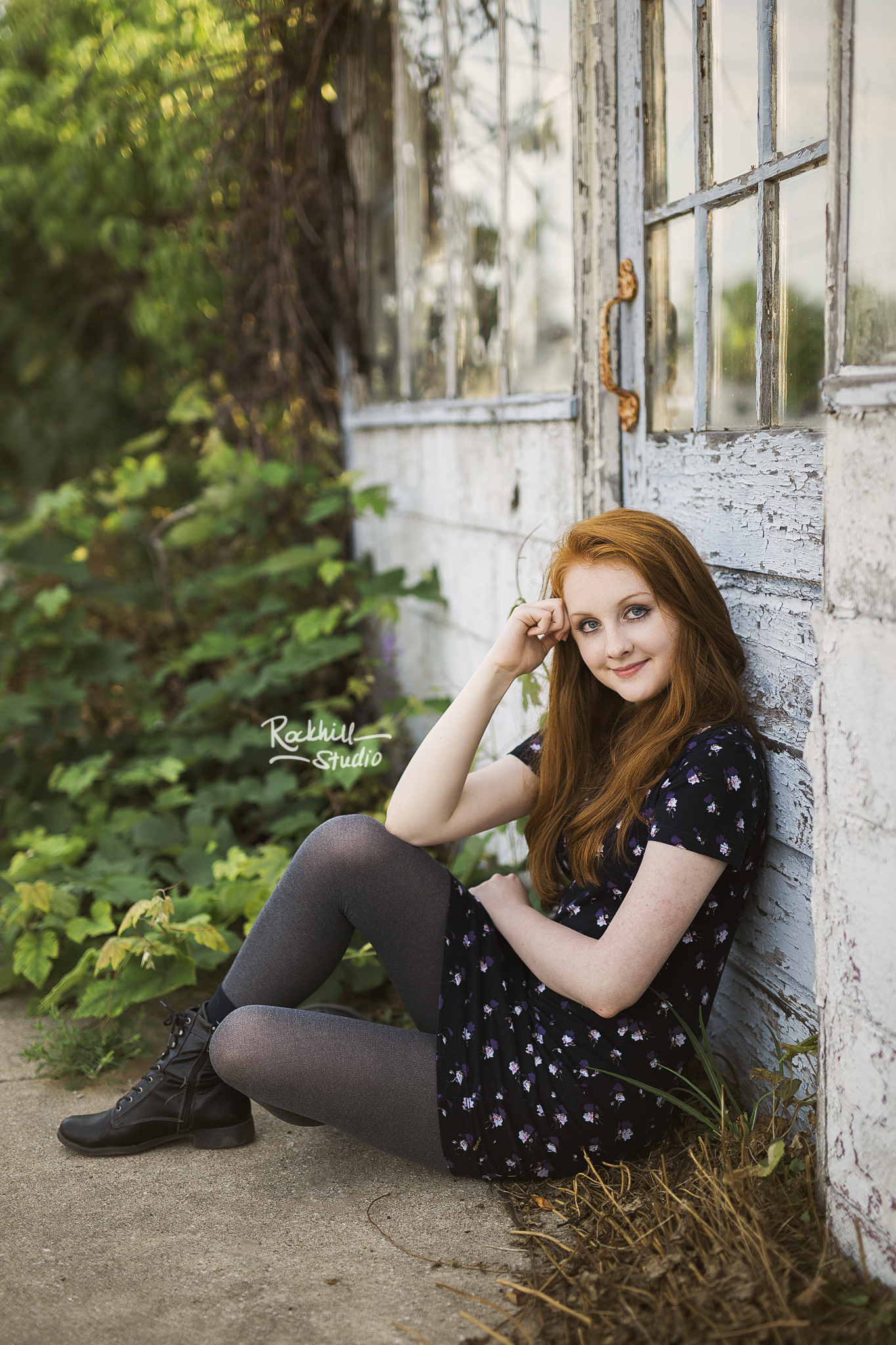 marquette-senior-photographer-upper-peninsula-michigan-girl-garden-wall.jpg