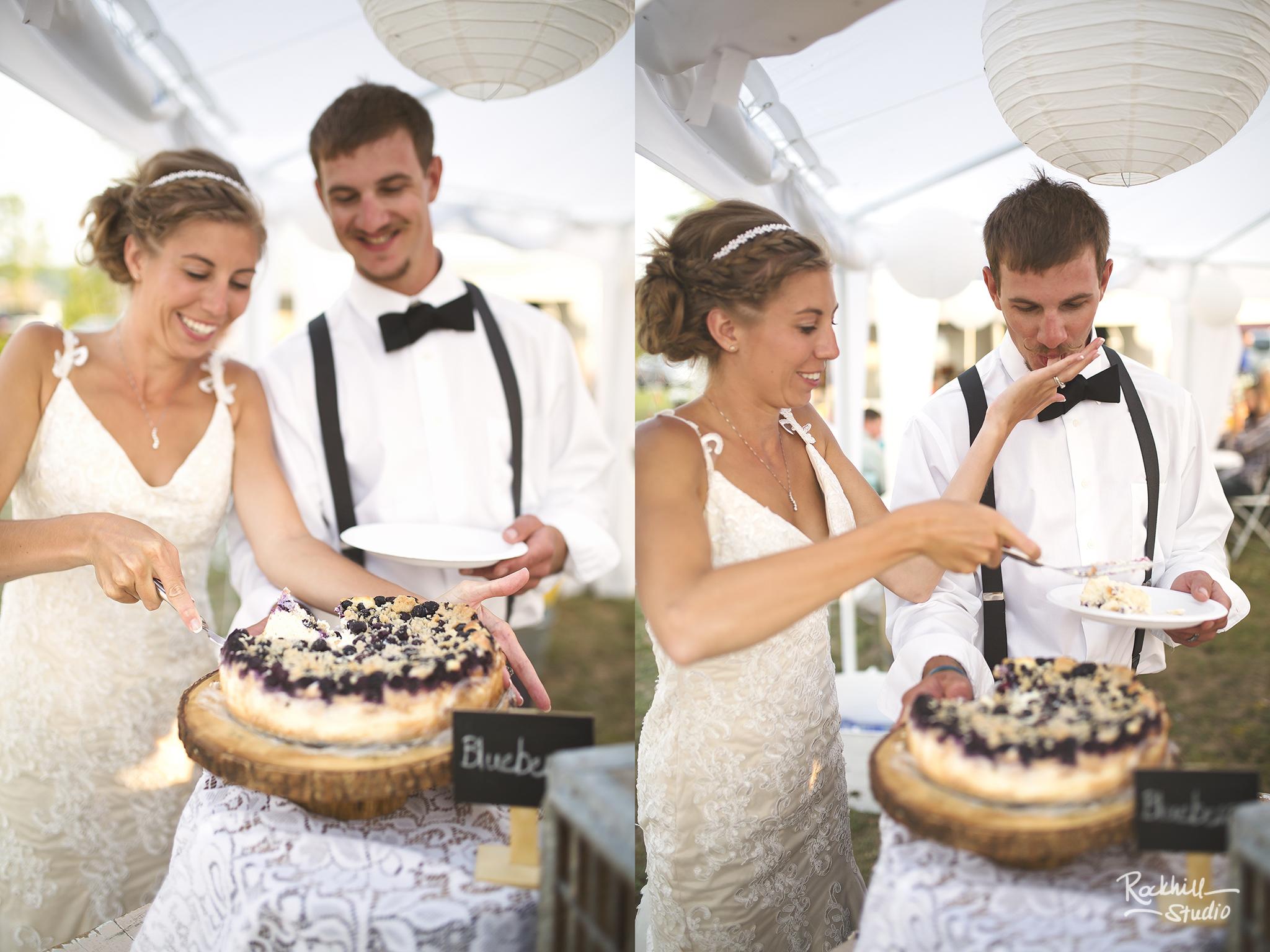 marquette-wedding-photography-lake-superior-cake-cutting-bride-groom-michigan.jpg
