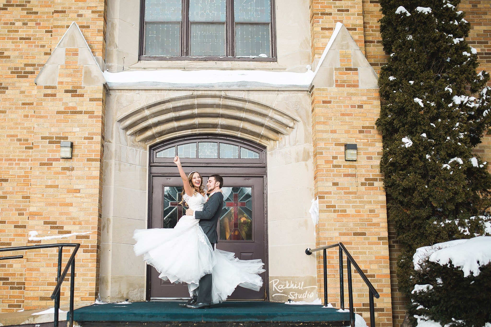 marquette-winter-wedding-photography-church-happy-michigan.jpg