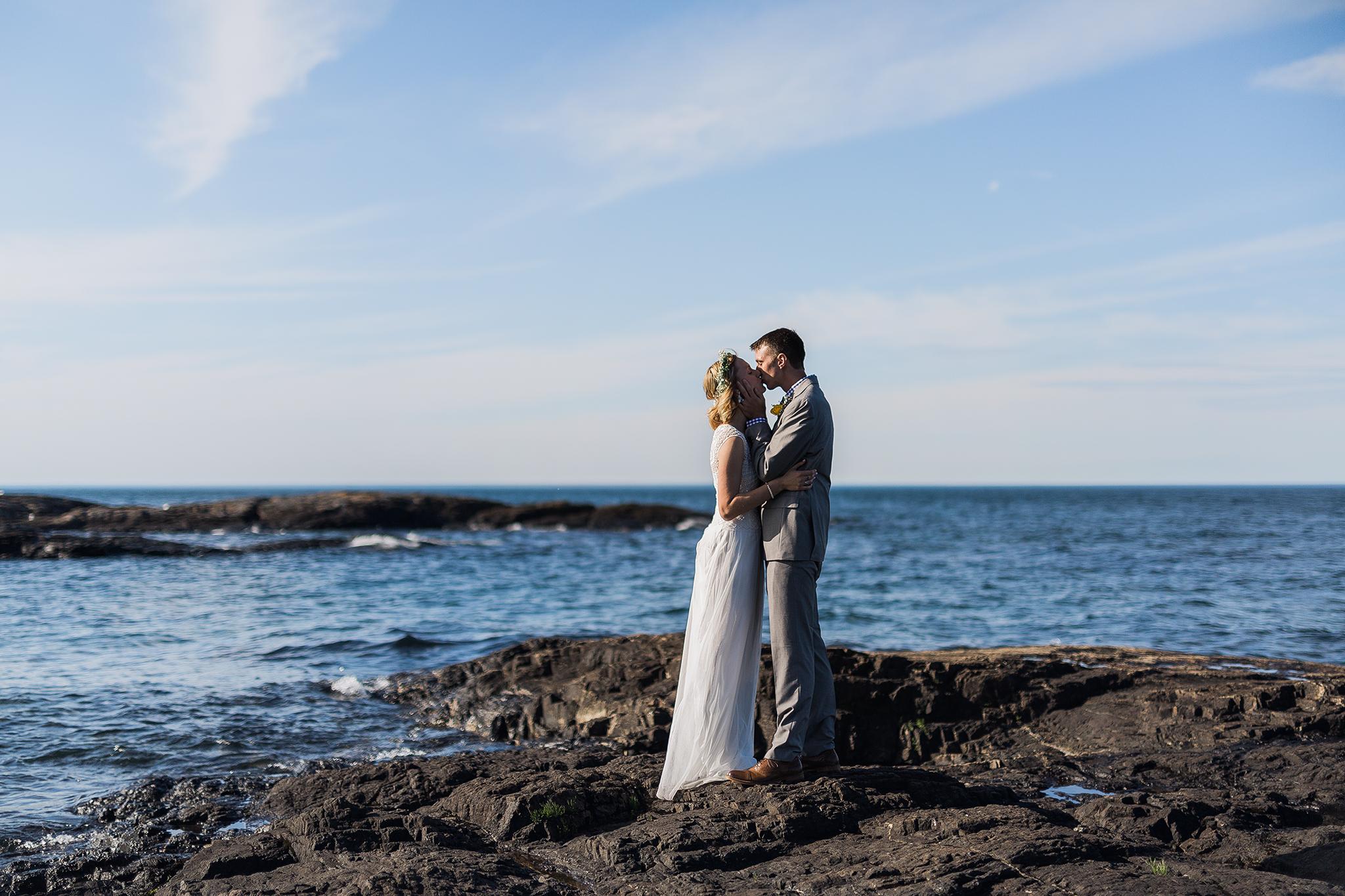 rockhill-studio-marquette-michigan-bride-groom-kissing-blackrocks-presque-isle.jpg