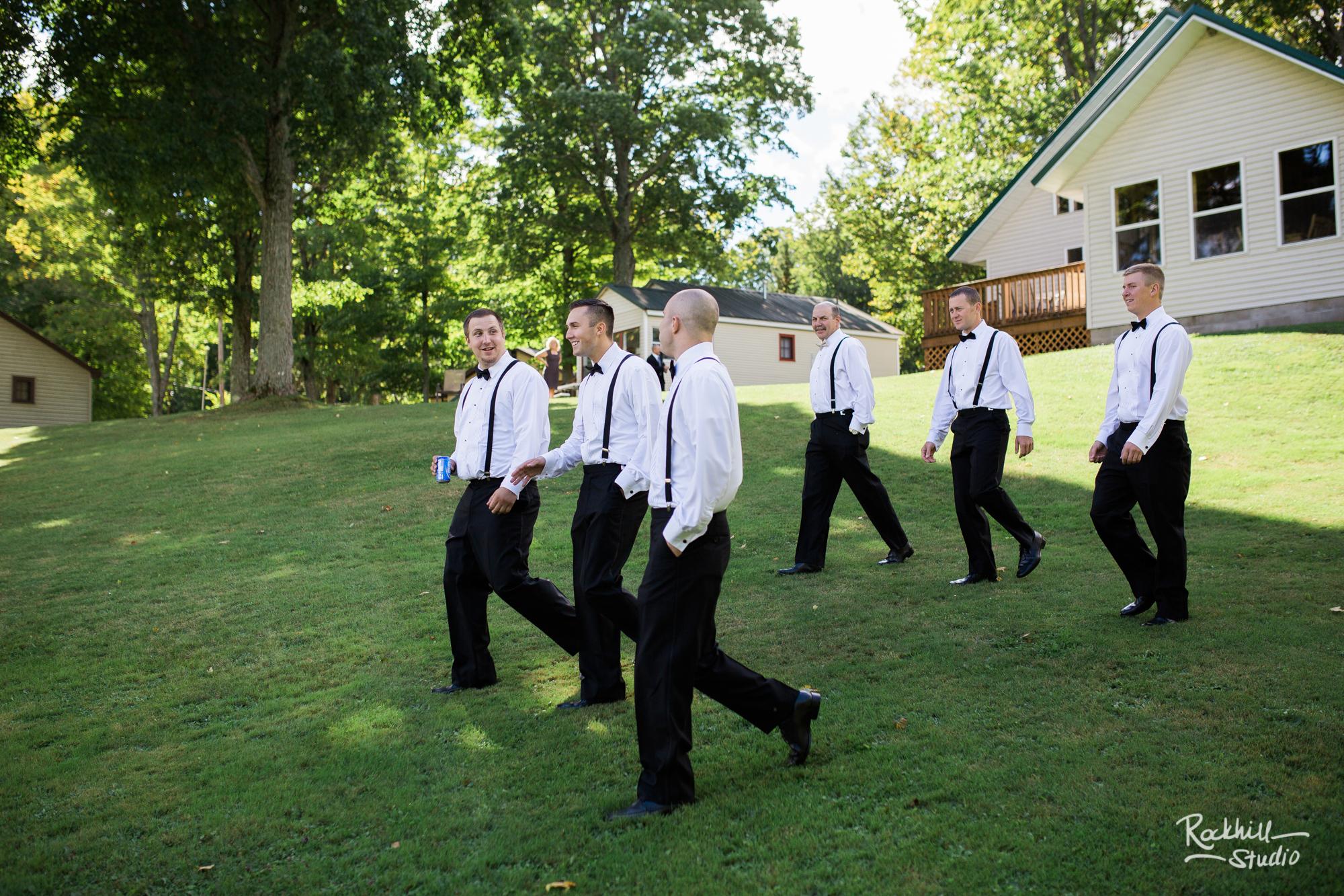 rockhill-studio-newberry-michigan-wedding-groomsmen-walking-fun.jpg