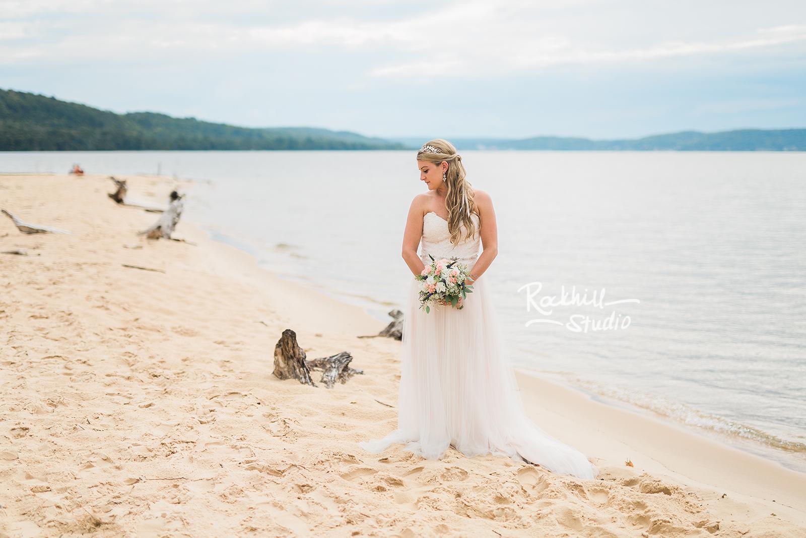 traverse city wedding photographer beach bride lake sand