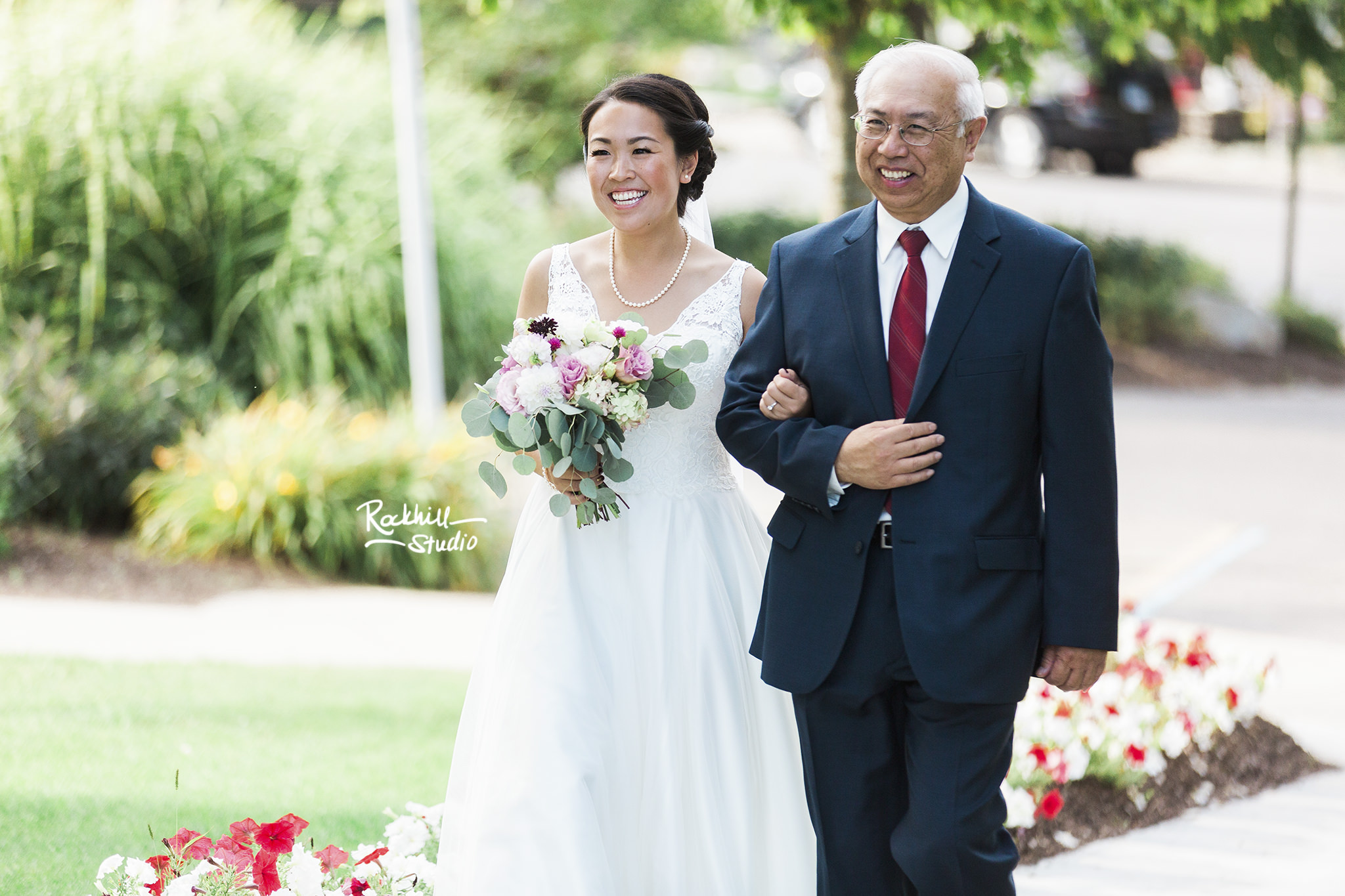 Northport wedding ceremony, bride walking down the isle, traverse city wedding photographer rockhill studio