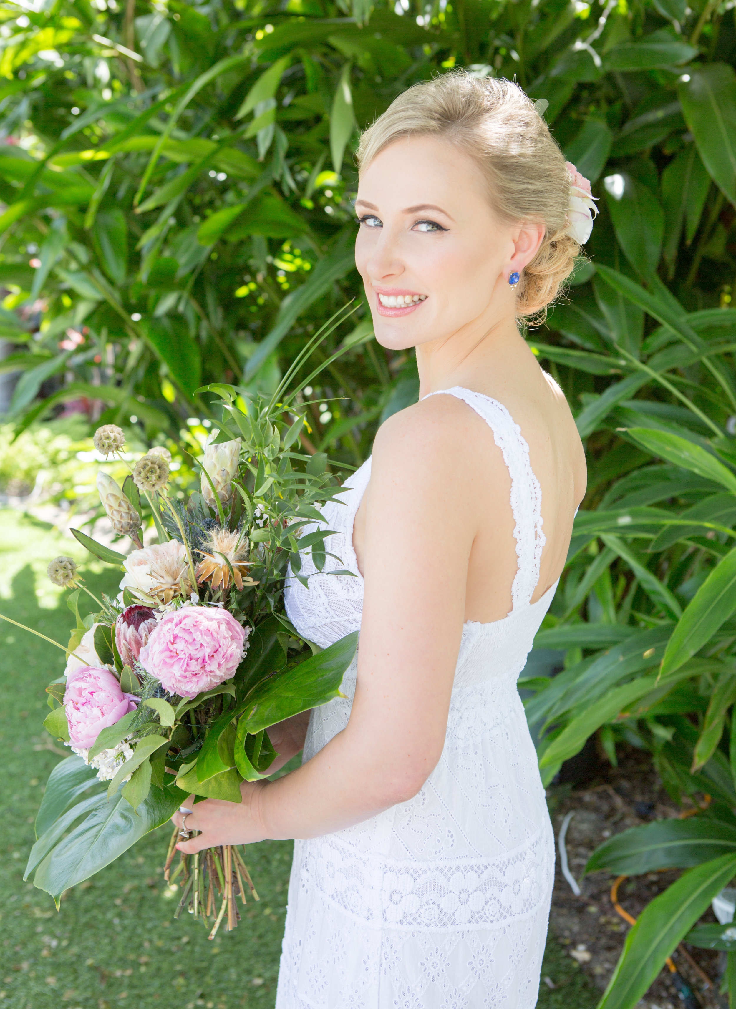 Bride with tropical wedding bouquet and wedding flowers for her hair
