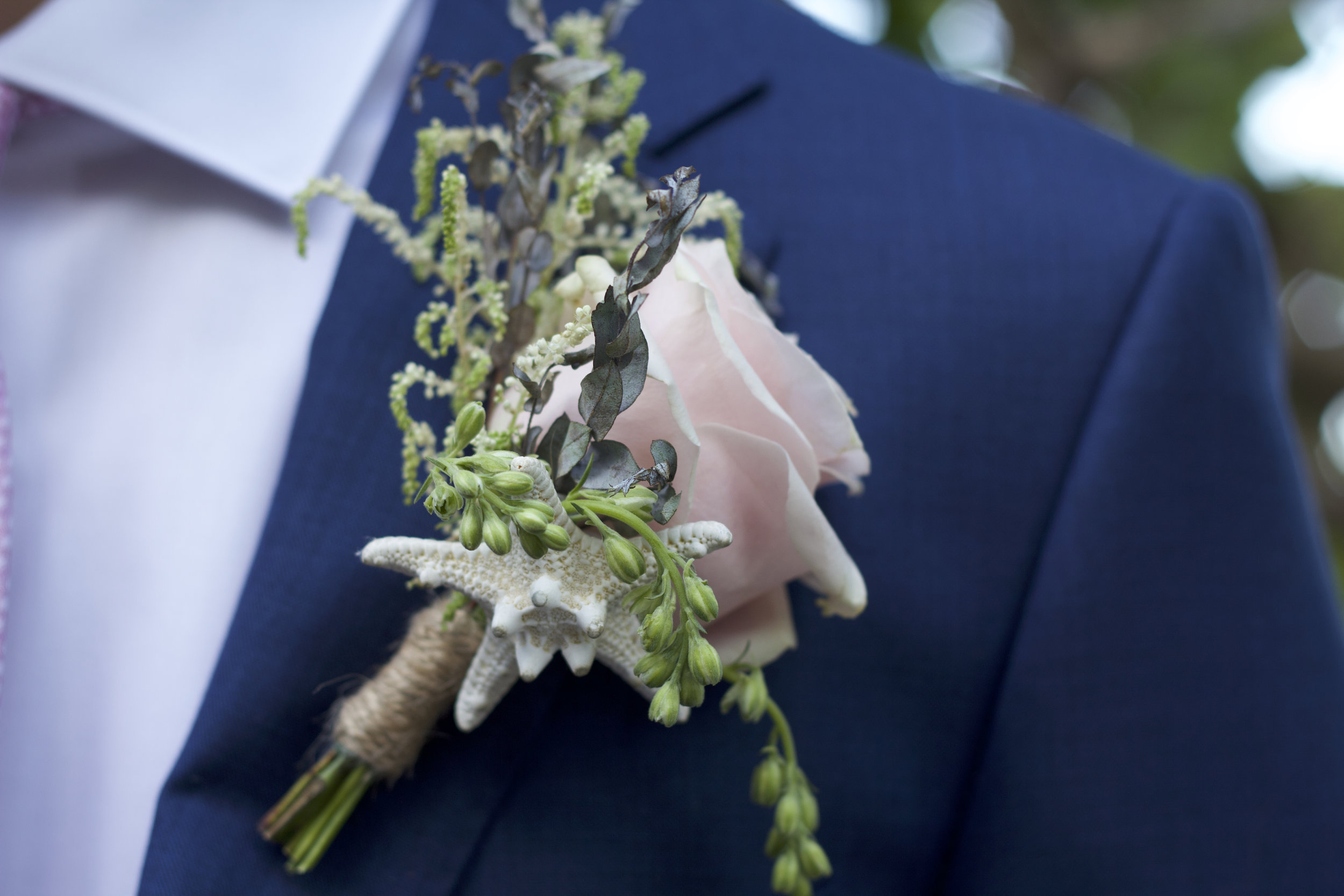 Groom wearing nautical boutonniere at Miami Beach wedding