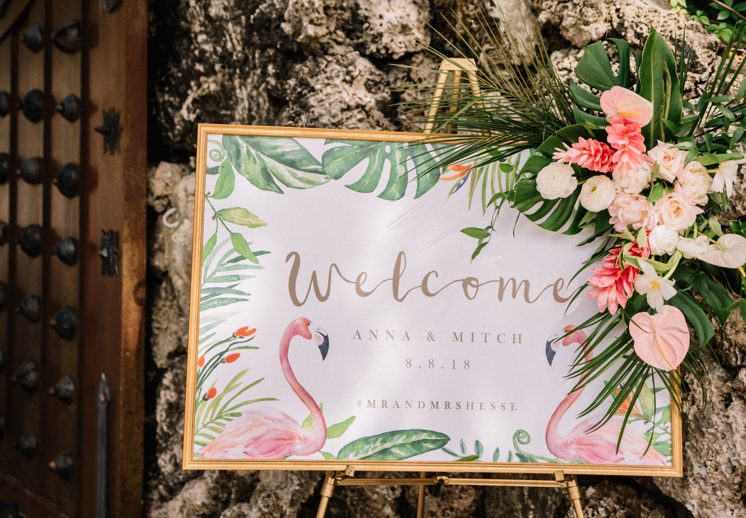 Romantic wedding flowers on wedding welcome sign at  Deering Estate  in Miami