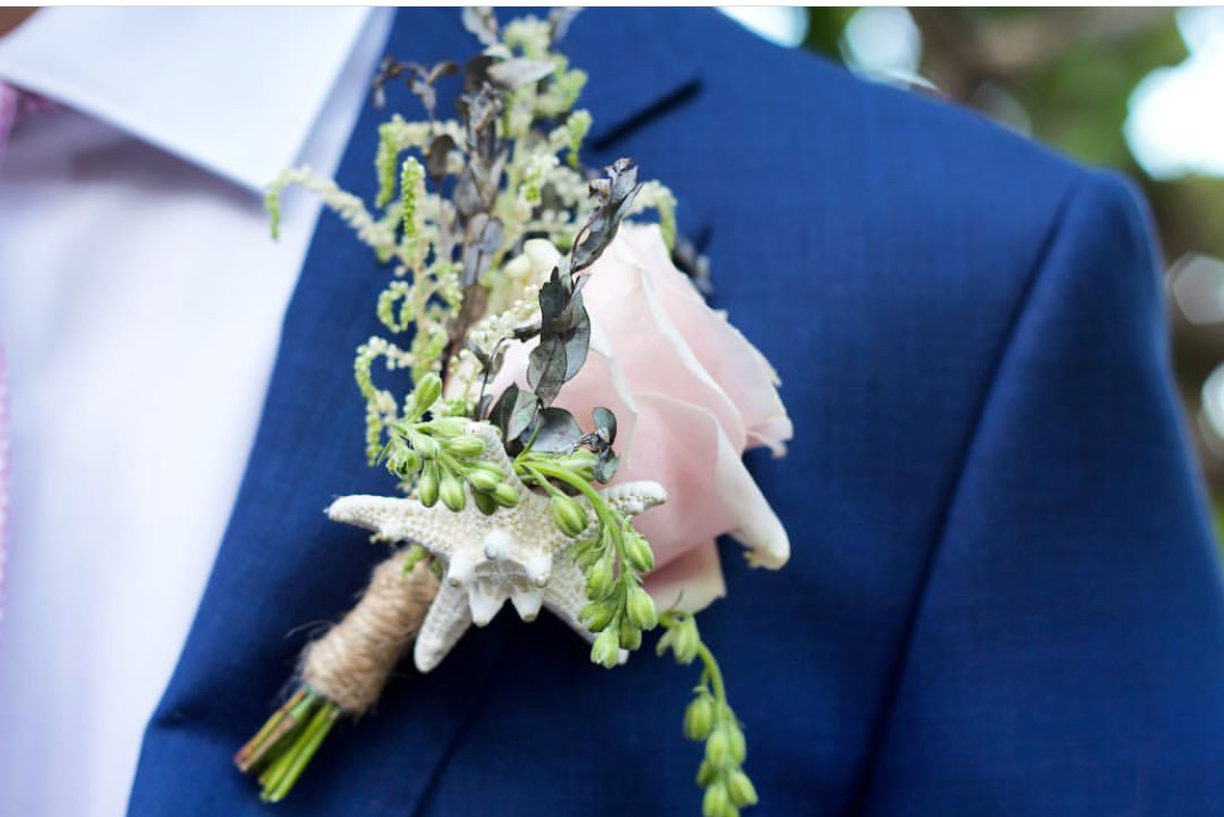 Beach inspired boutonniere for Miami Beach wedding groom