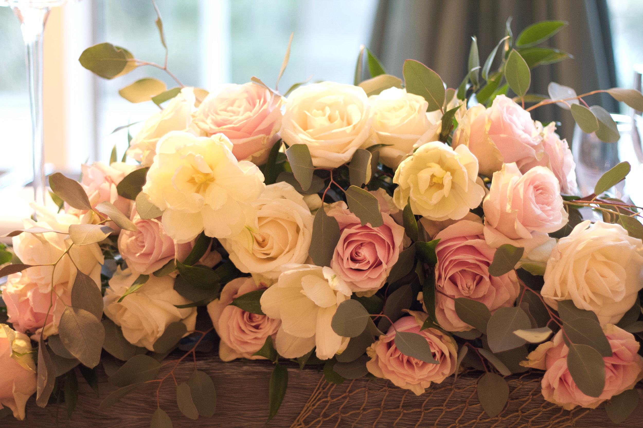 Head table floral arrangement for beach wedding in Miami Beach Florida