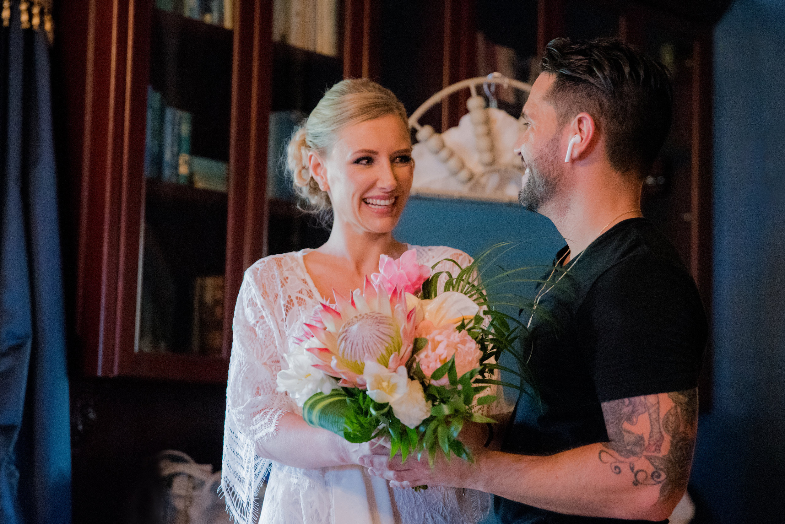 Christopher Plaza presents tropical wedding bouquet to Anna, his Miami bride
