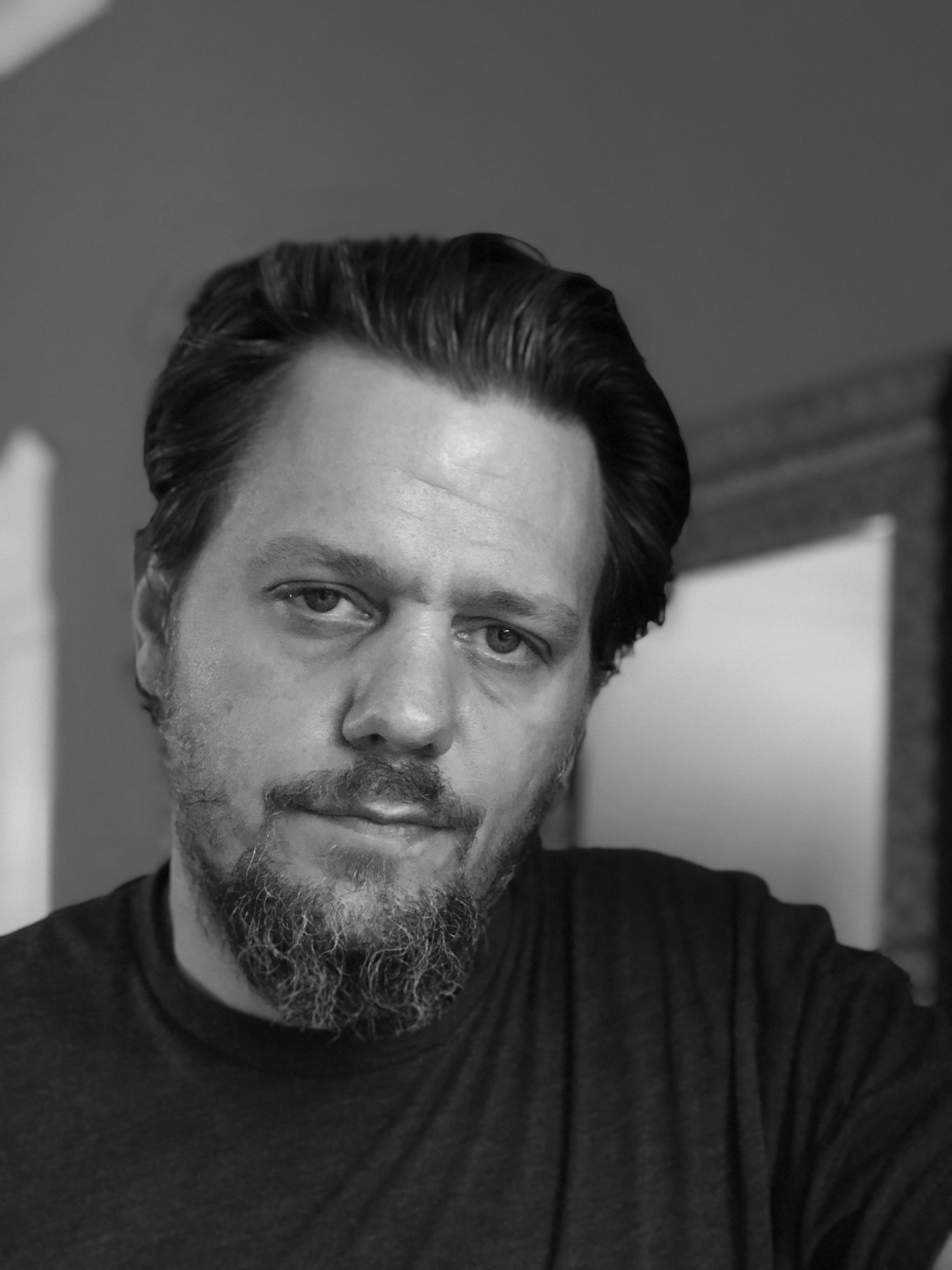 R.W. headshot 2018 black and white.jpg