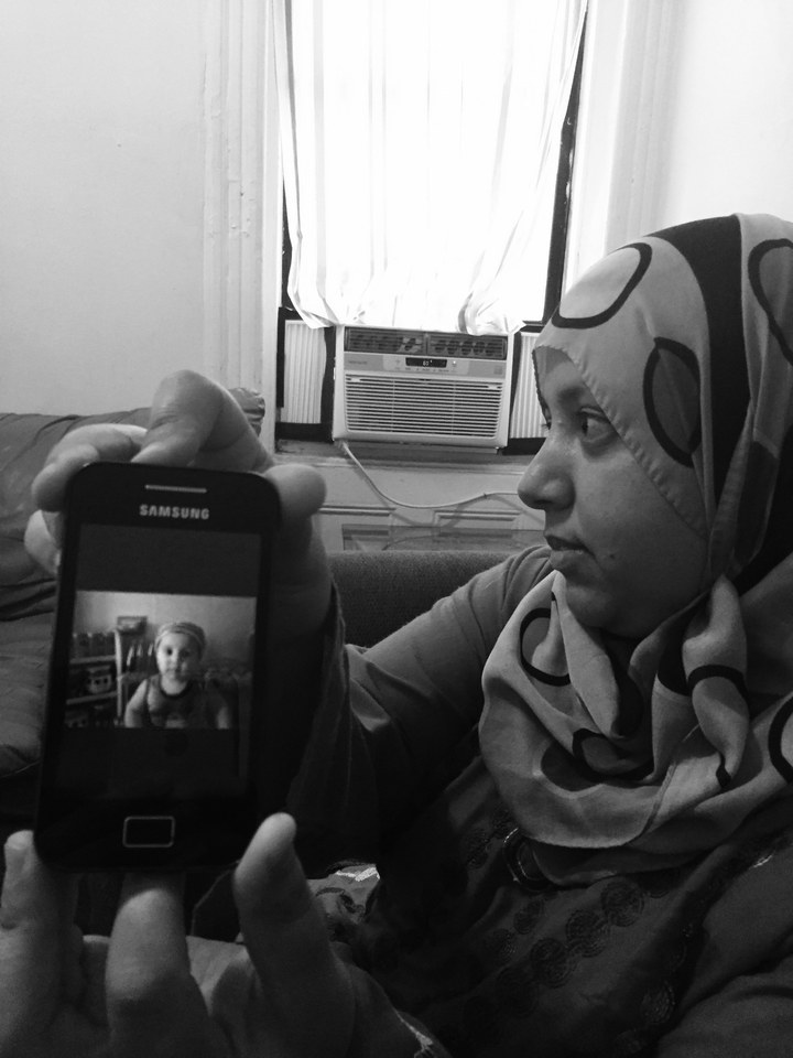 Soha shows a photo of her nephew, who is still in Homs, Syria.  Purvi Thacker/ BuzzFeed News