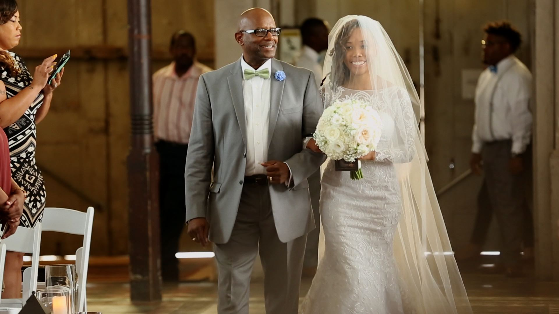 Her beautiful veil and blusher made her glow walking down the aisle!