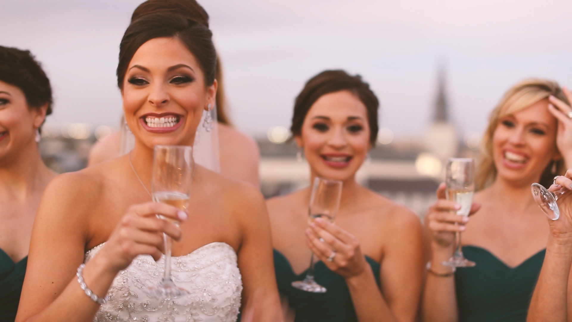 The girls prepared to head to the ceremony with a rooftop champagne toast!