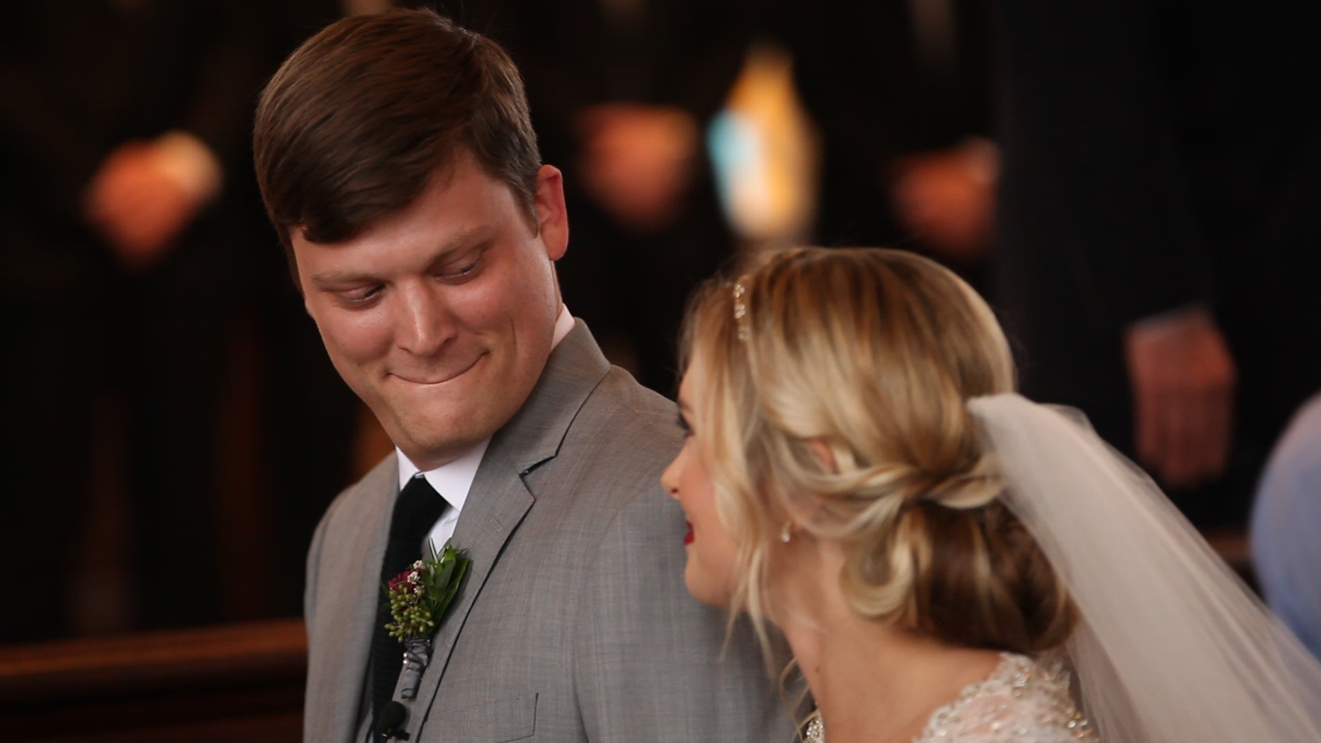 We love this sweet moment between the bride and groom right as they met at the alter.
