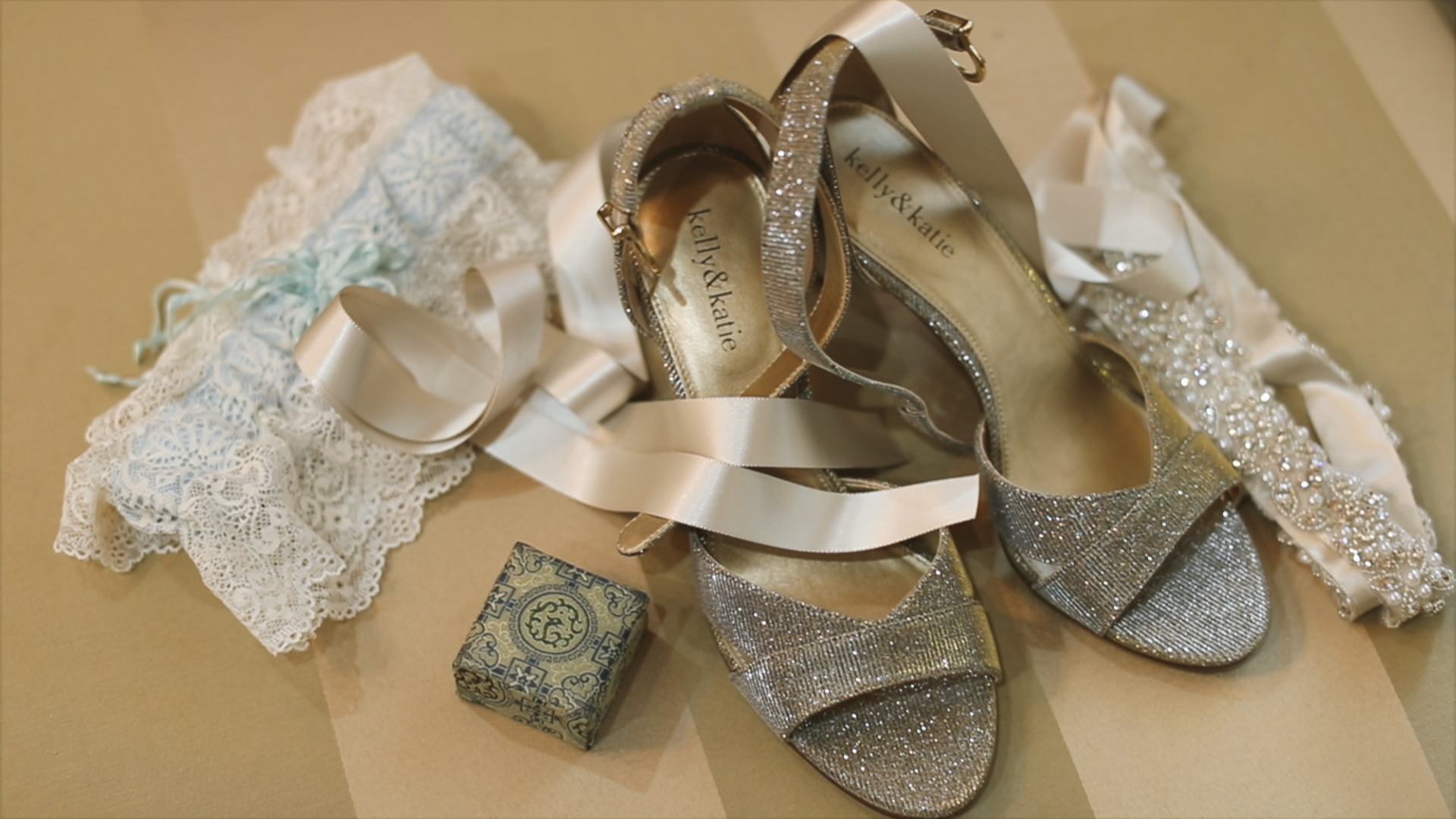 Gabby and Patrick_Bride detail shot garter and shoes