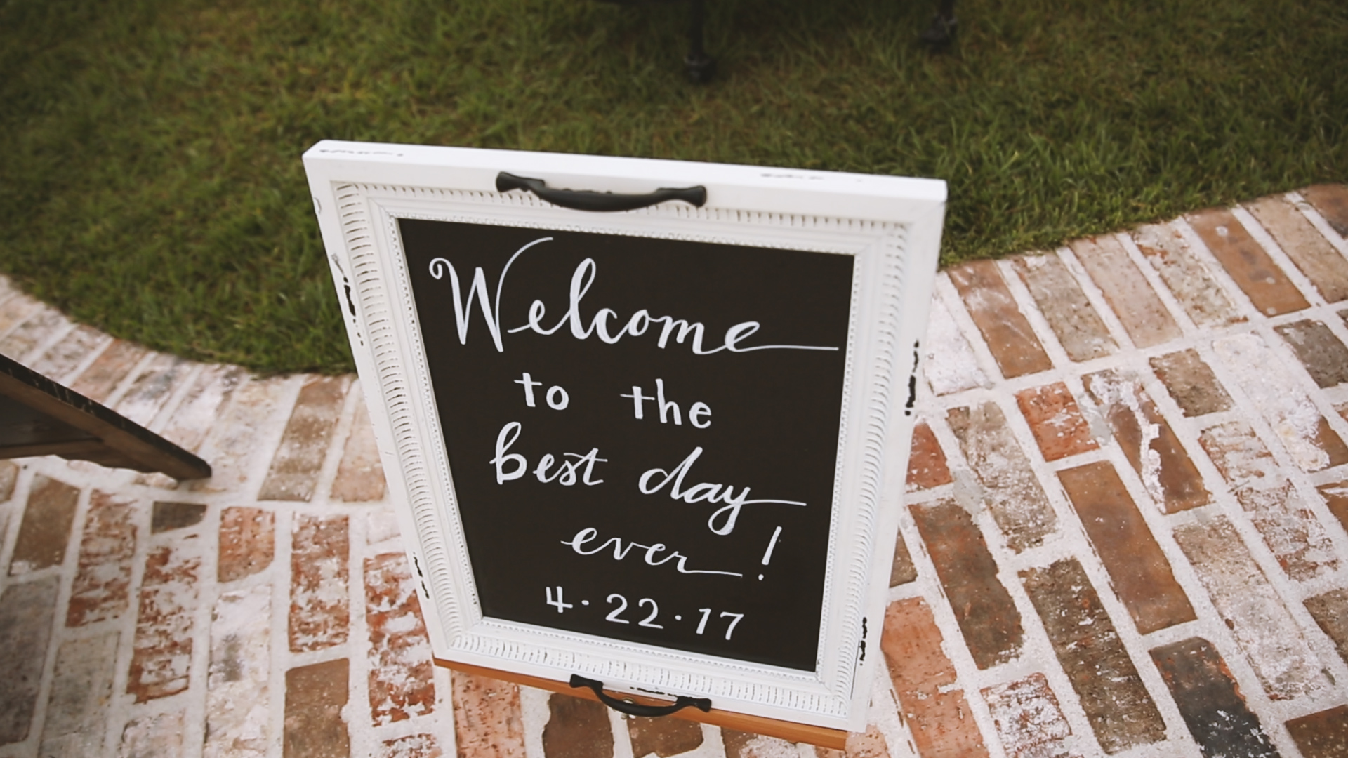 Amanda and Hayden_The White Magnolia Farm Weddings_New Orleans videographer_Wedding ceremony sign