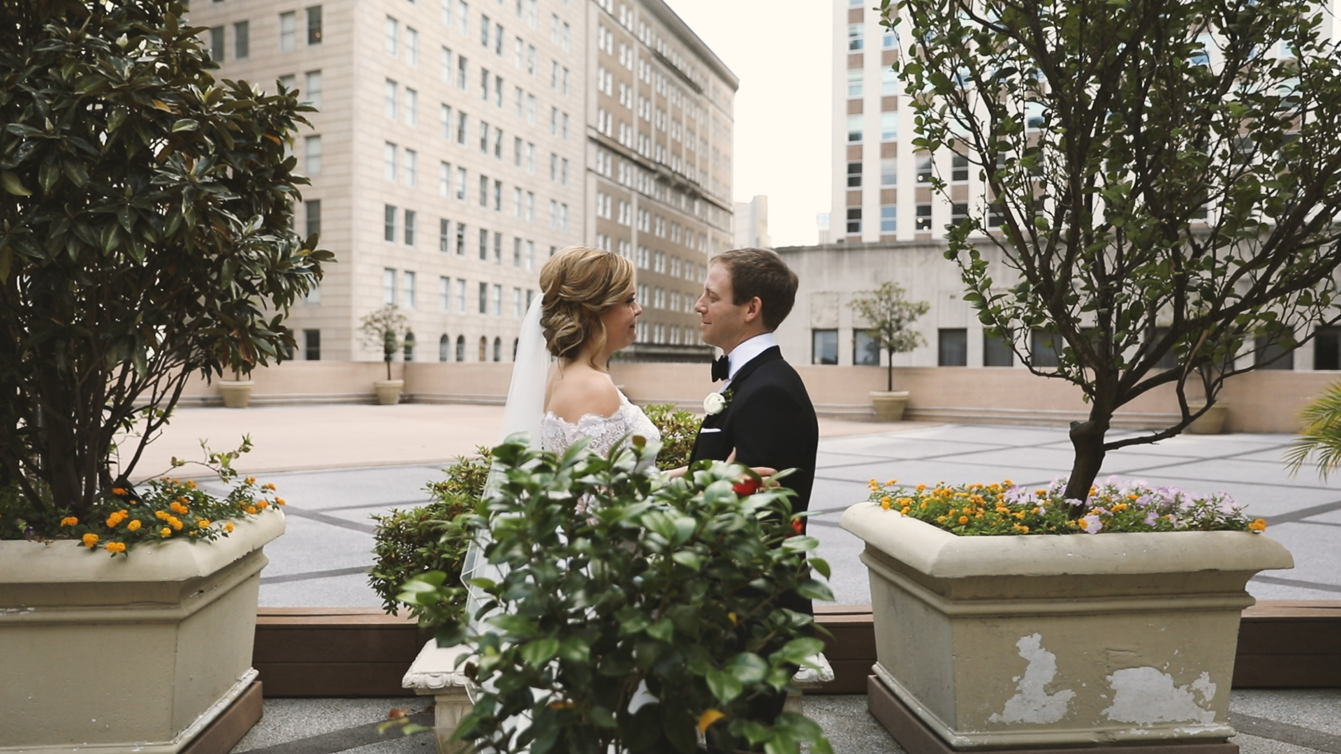 Colleen and Charles_Urban Contemporary Arts Center Wedding_New Orleans videographer_First look roof top
