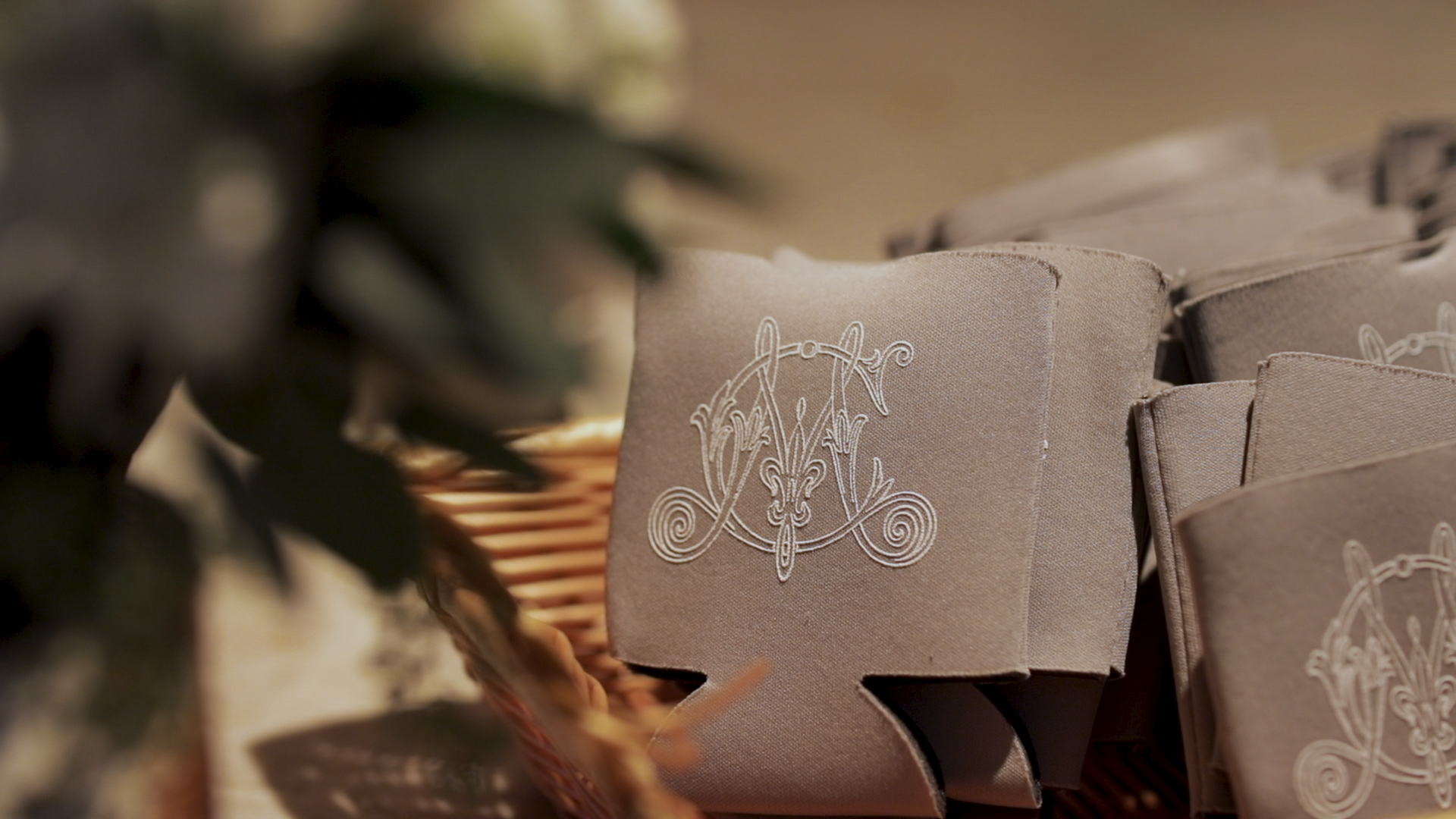 New Orleans Wedding Videography_Marianne and Clark_Wedding coozie logo