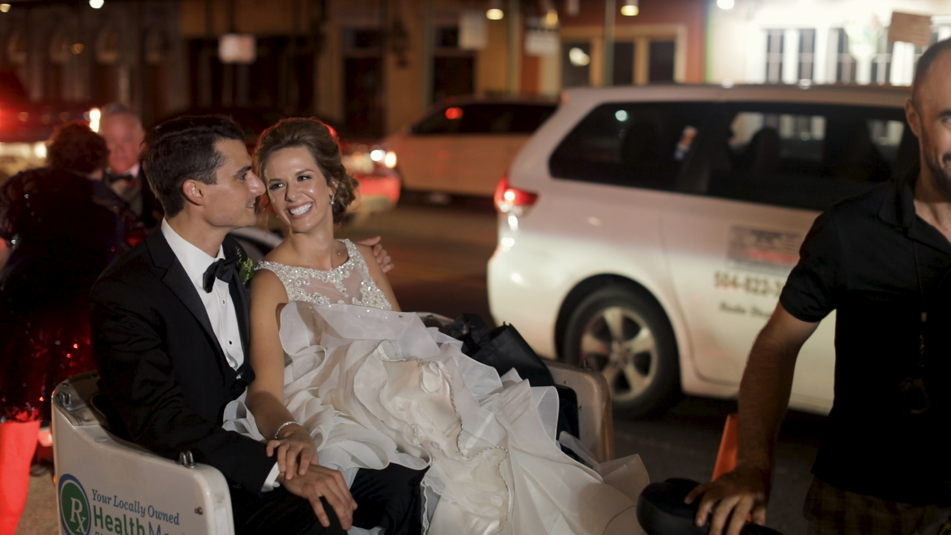 New Orleans Wedding Videography_Marianne and Clark_Wedding Exit on bike buggy