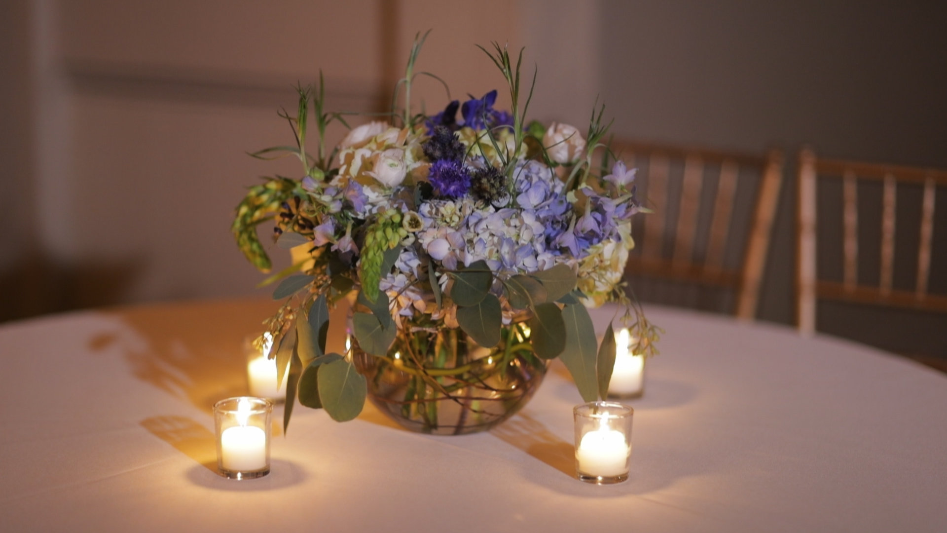 Anya and Max_New Orleans Wedding Video_Bride Film_Board of Trade reception_floral centerpiece