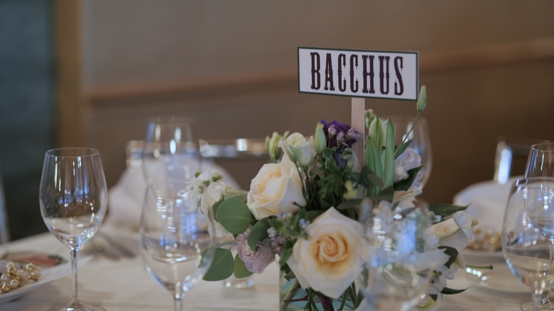 New Orleans Wedding Video_Sibyl and Charles_Commanders Palace Rehearsal Dinner_mardi gras centerpiece