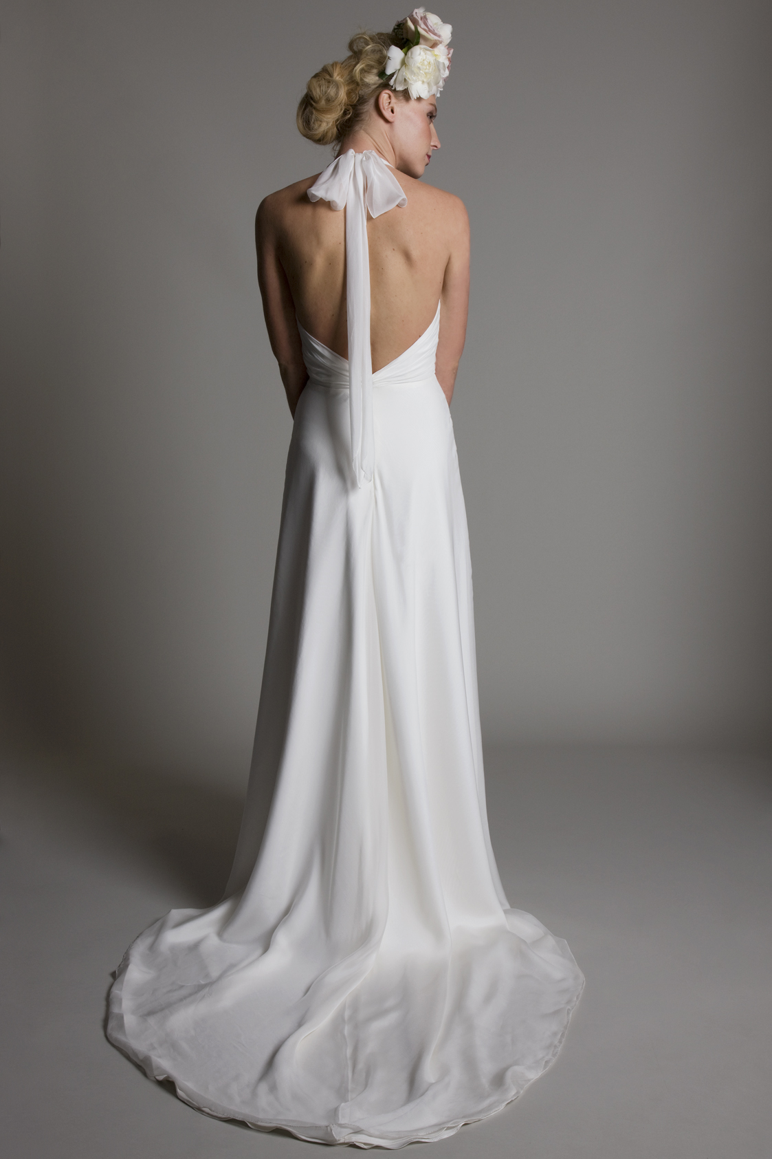 Back view of the Marilyn halter neck chiffon gathered top with chiffon A line skirt and low back bridal wedding dress by Halfpenny London