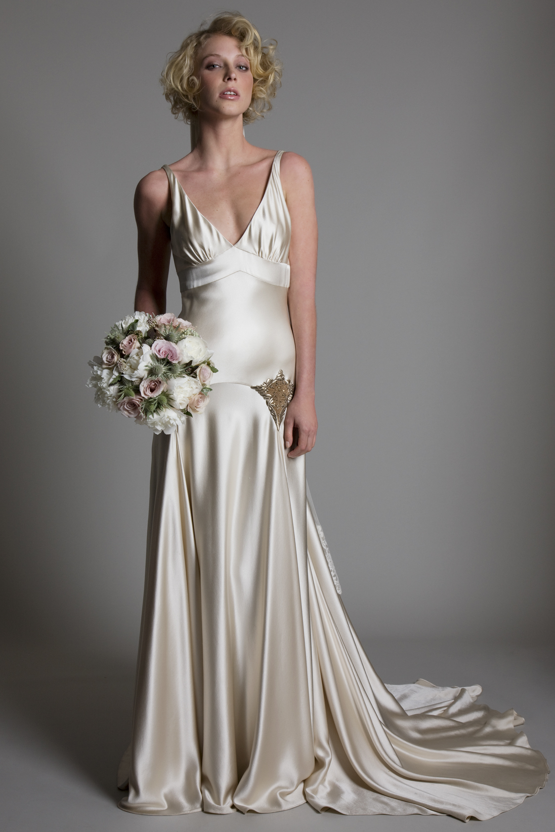 Milly Bafta V neck and low V back greige bridal wedding dress with godgets and embellishment detailing by Halfpenny London
