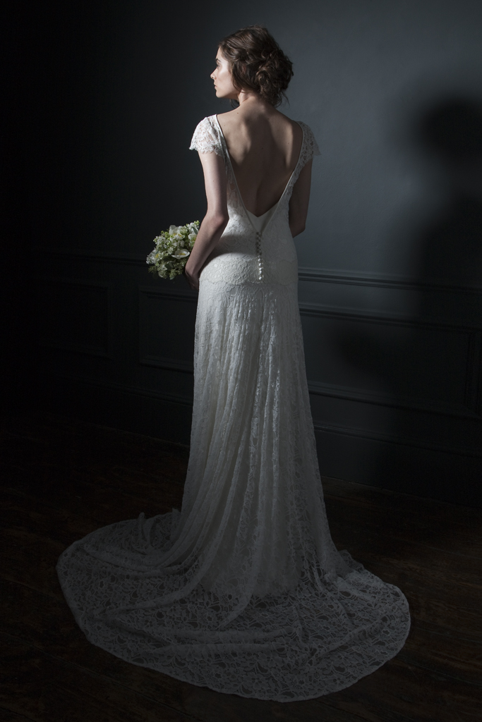 Back view of the Violet Full french lace, low V open back and button details with cap sleeves and V neck crepe back silk Slip Bridal wedding dress by Halfpenny London