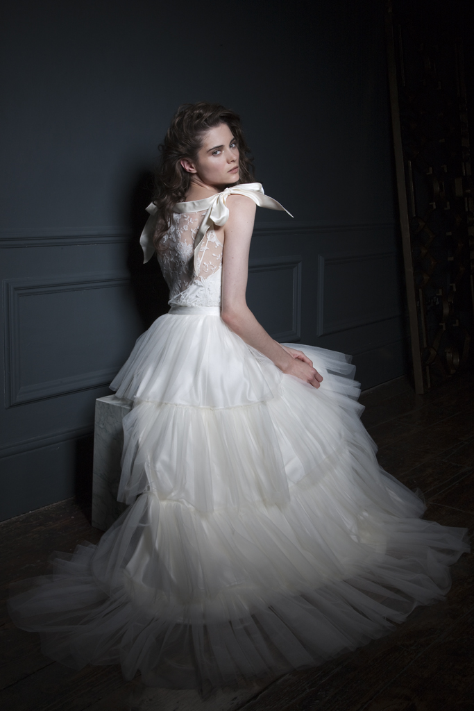 Side view Irene French Lace Tee and silk bow shoulder details paired with the Rita silk tulle frill skirt Bridal wedding dress by Halfpenny London