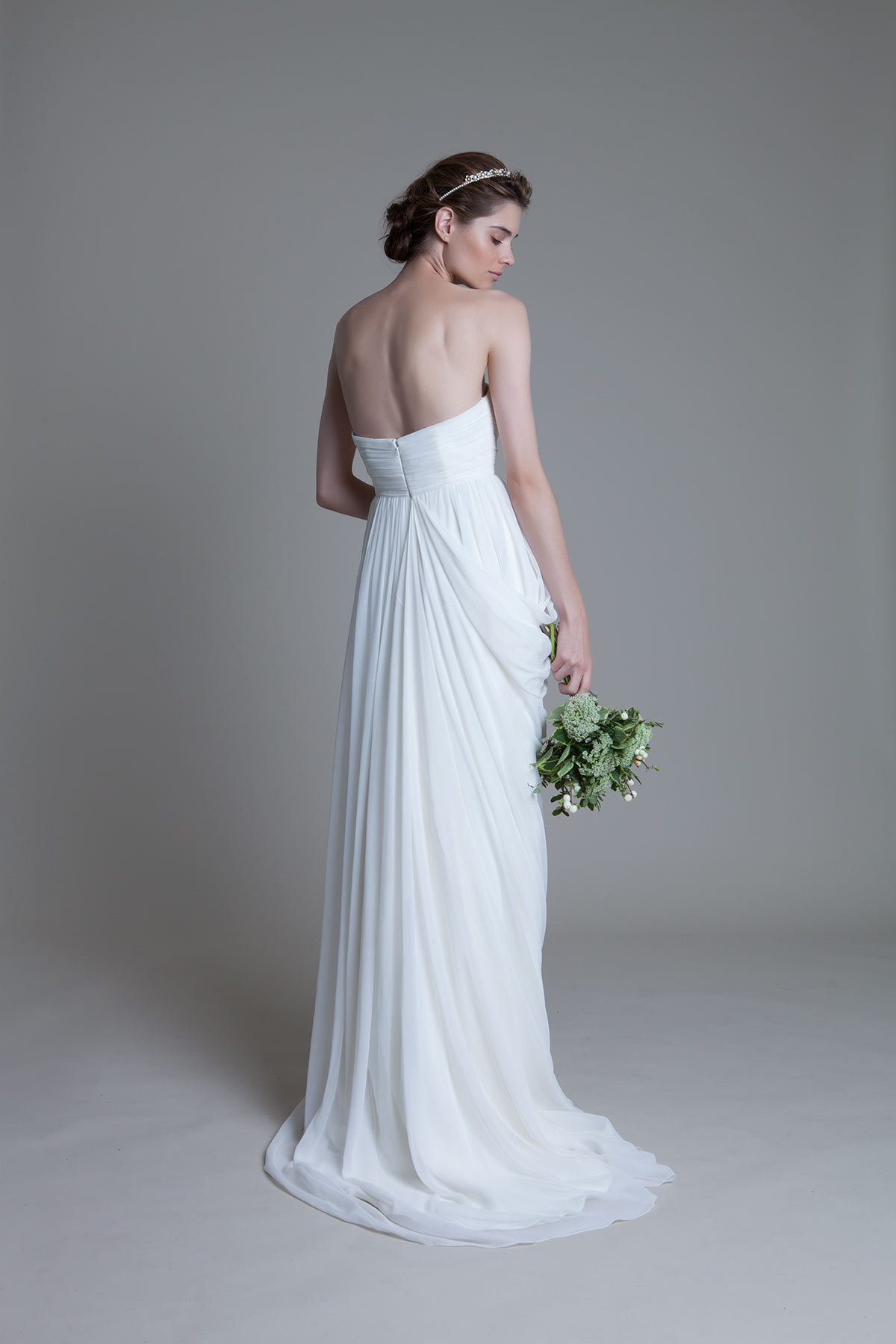 Back View of the Georgina soft pleated chiffon boned bodice with a draped grecian chiffon skirt with train bridal wedding dress by Halfpenny London