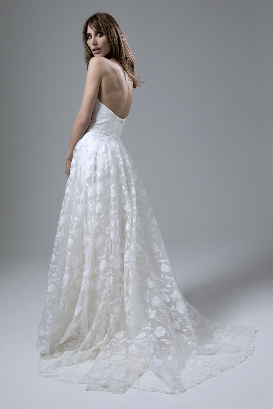 Back view of the Esme Embroidered Organza Strapless Wedding Dress with Circular Skirt by Halfpenny London