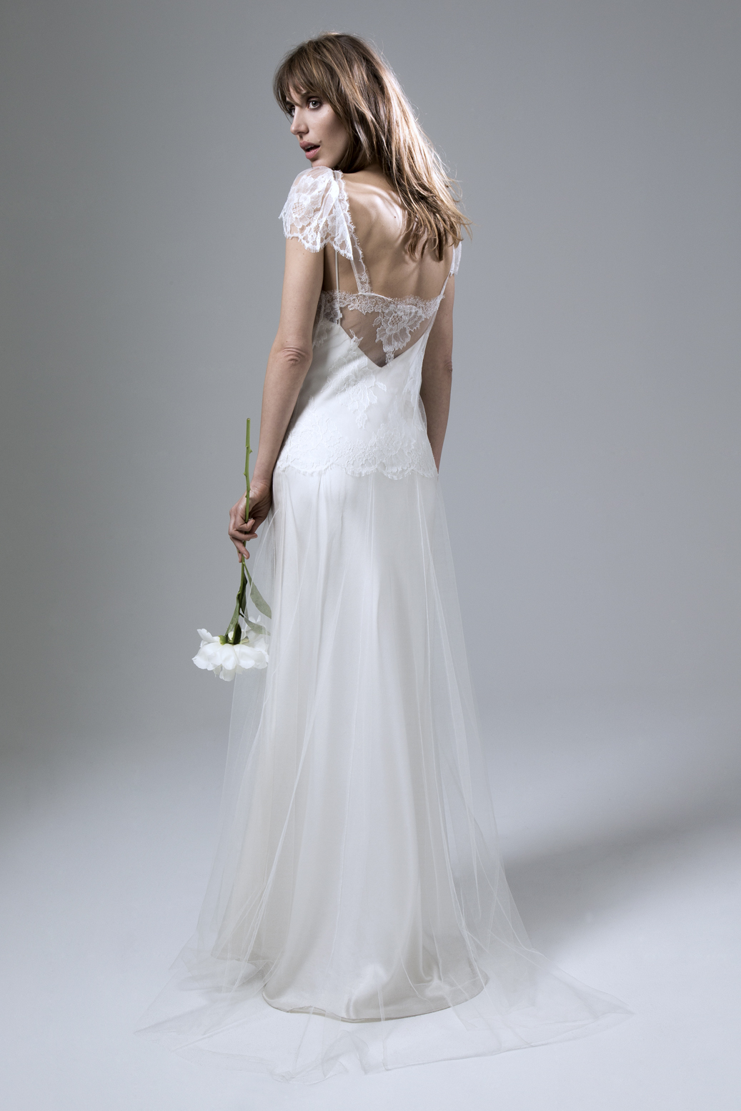 Back view of the Fifi French Lace and Silk Tulle Wedding Dress by Halfpenny London