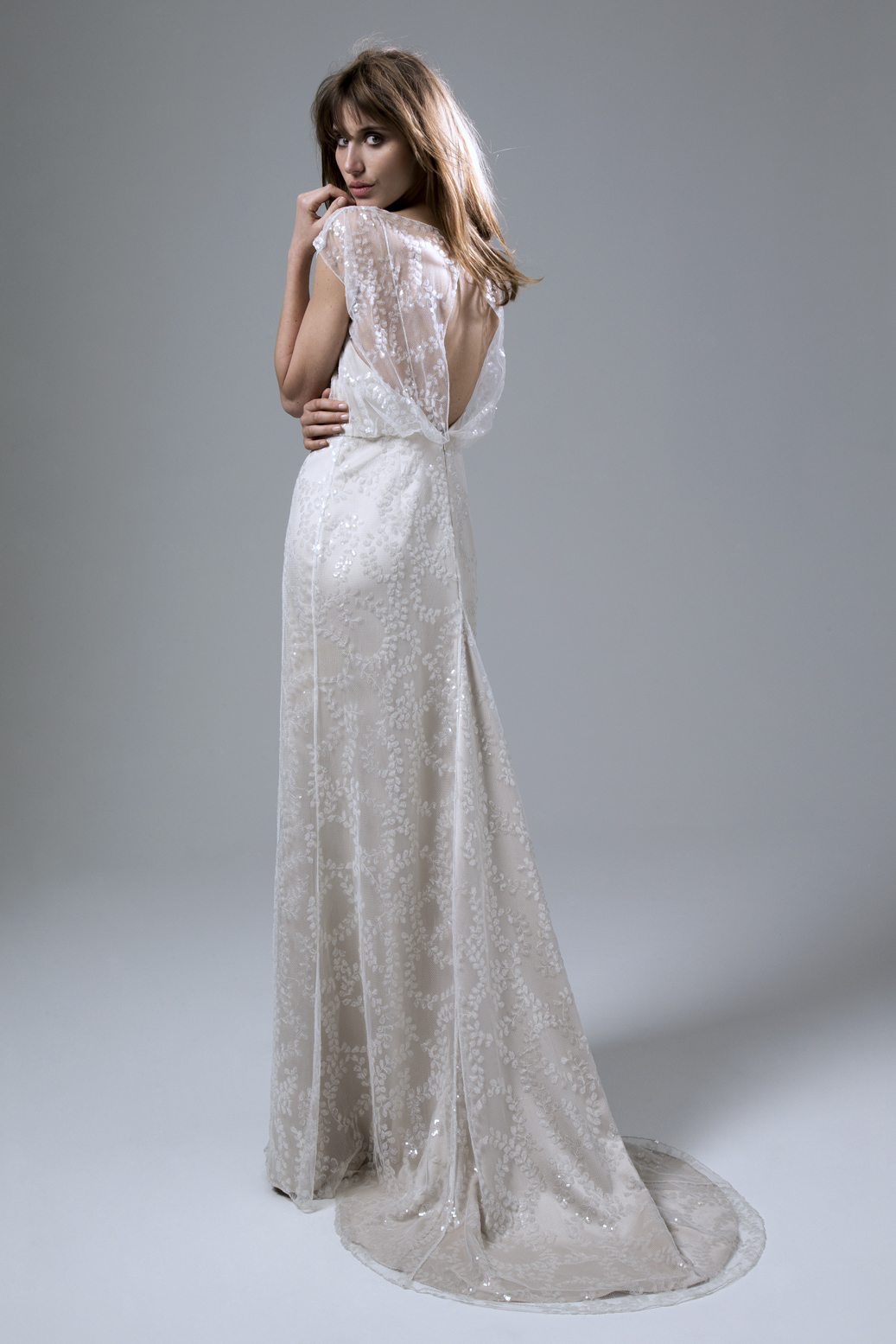 Back view of the Lydia sequin blush slash neck Wedding Dress with puddle train by Halfpenny London