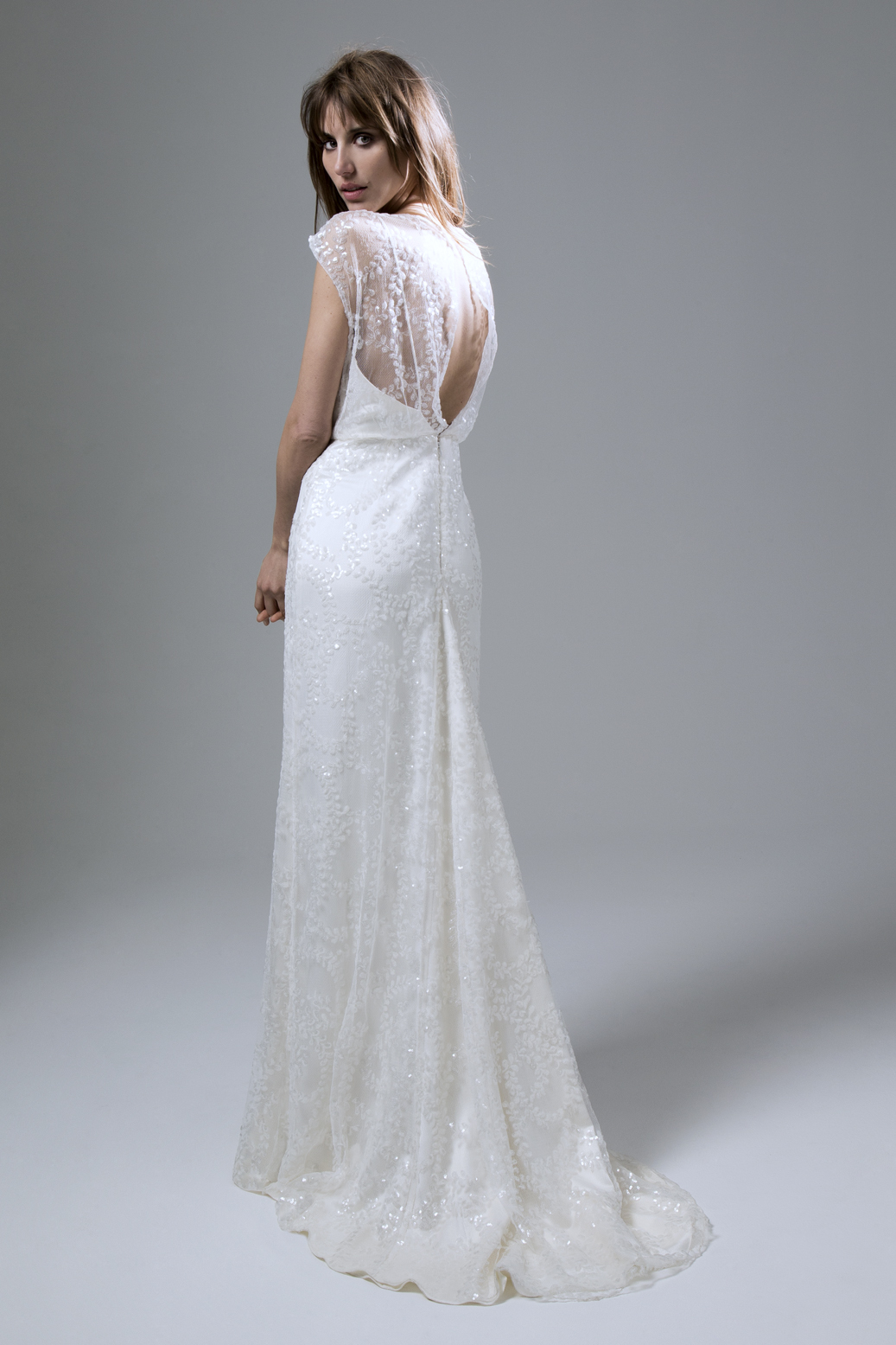Back view of the Lydia sequin ivory slash neck dress with puddle train wedding dress by Halfpenny London