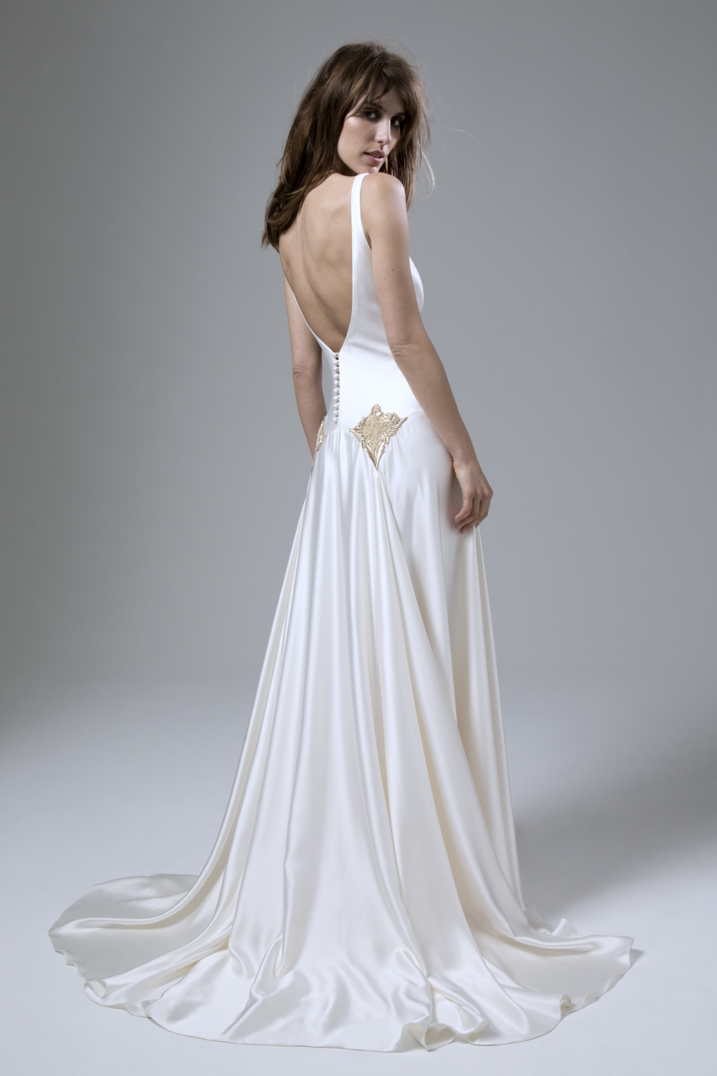 Back view of the Milly Bafta V neck and low V back wedding dress with godgets and embellishment detailing by Halfpenny London