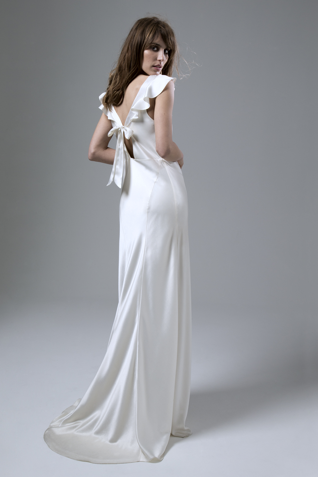 Back view of the Sarah soft cowl neck and empire line bias cut satin wedding dress by Halfpenny London