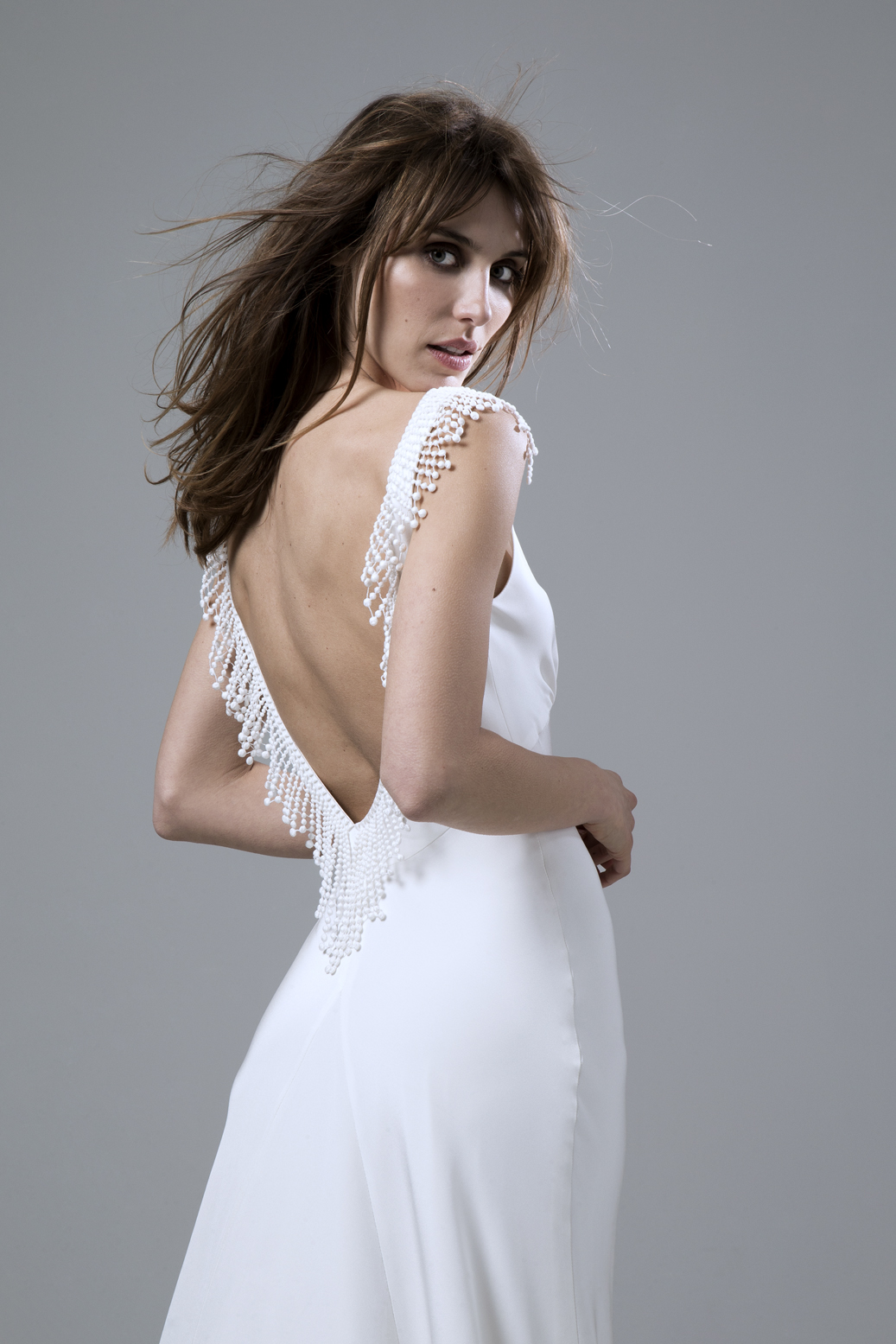 Detailed view of the Vera bias cut backless silk crepe dress with french embroidery wedding dress by Halfpenny London