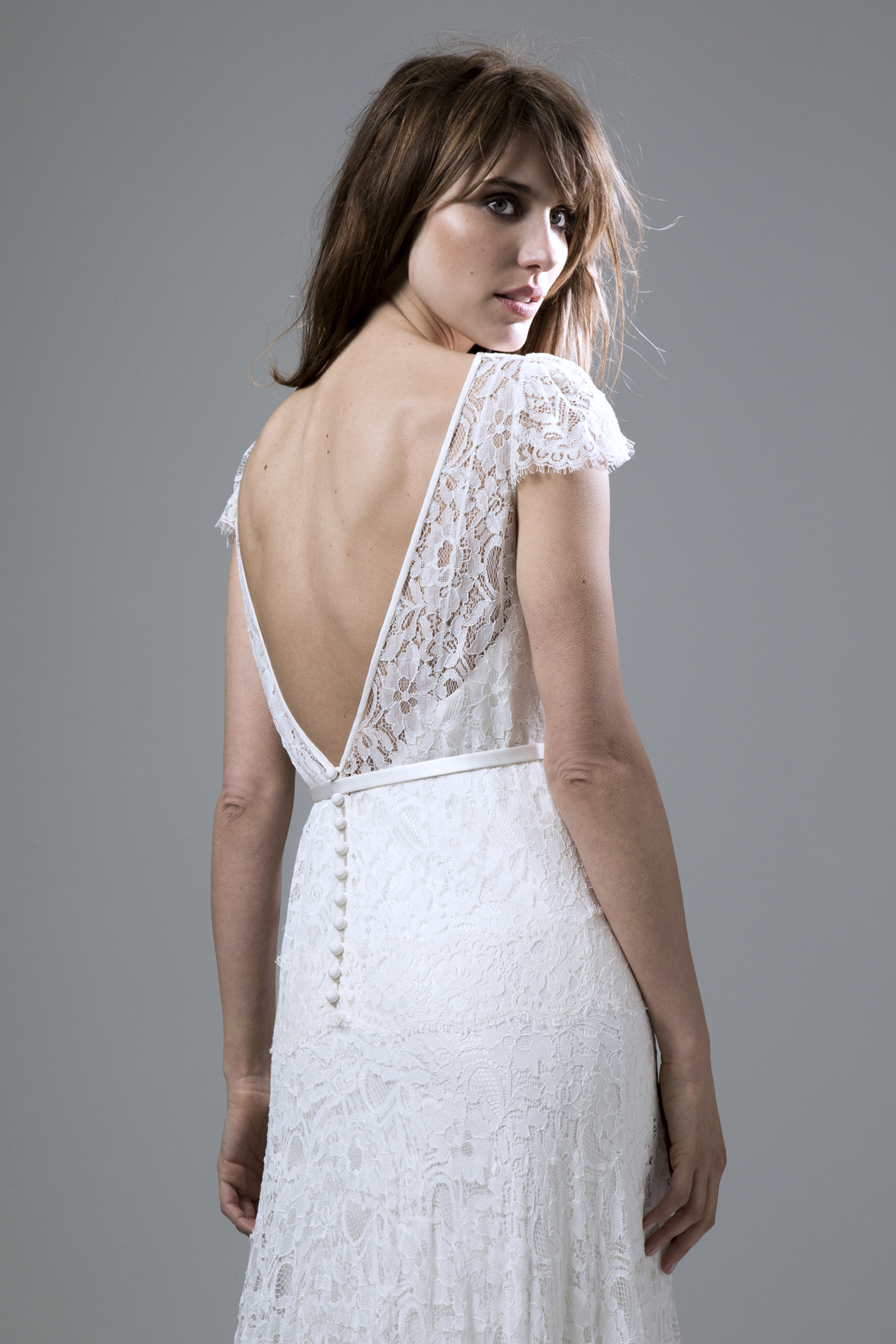 Back view of the Violet soft fine corded lace backless dress with a dropped waist wedding dress by Halfpenny London