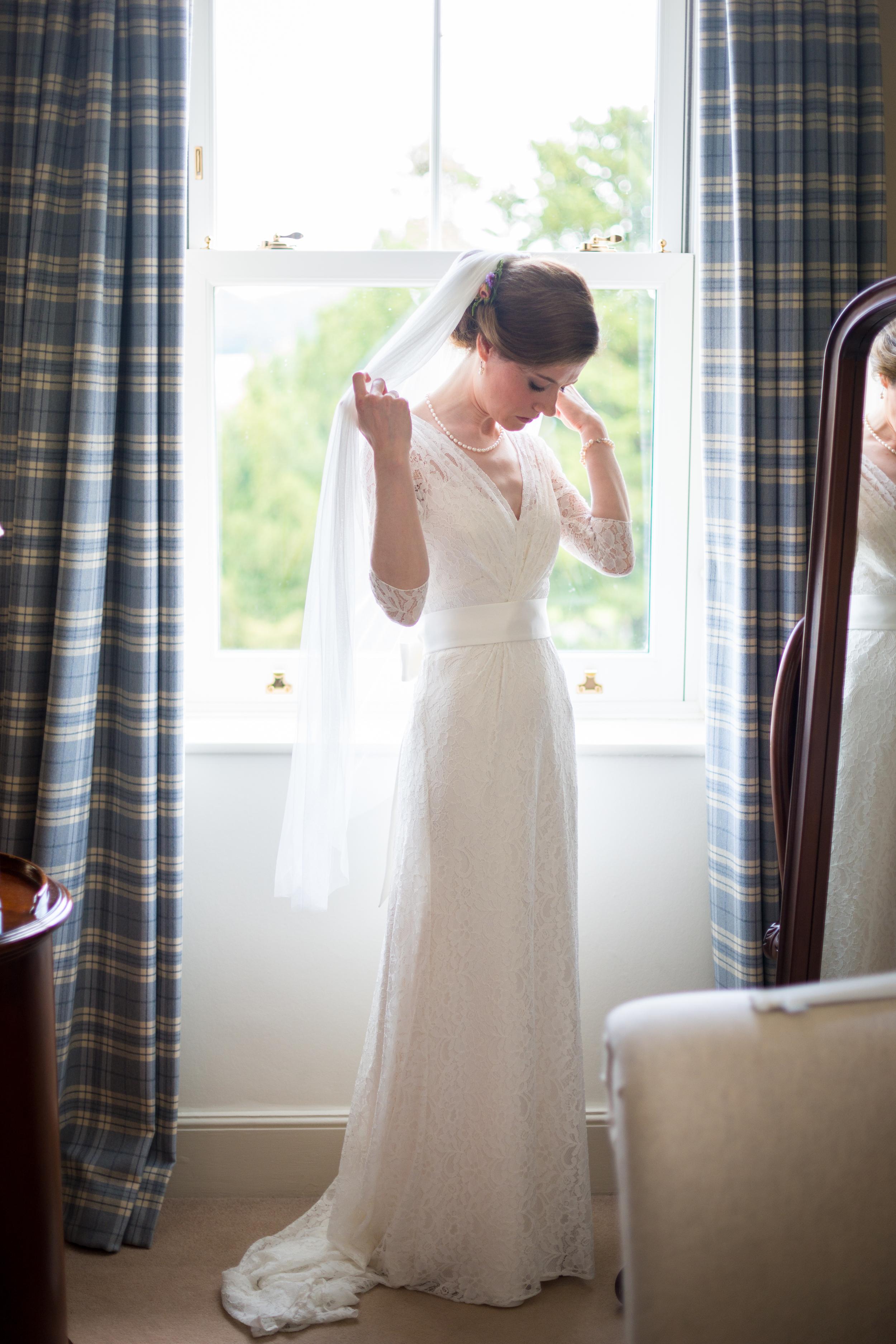 Freya wears the Halfpenny London Josephine wedding dress with a broad sash and fine tulle veil