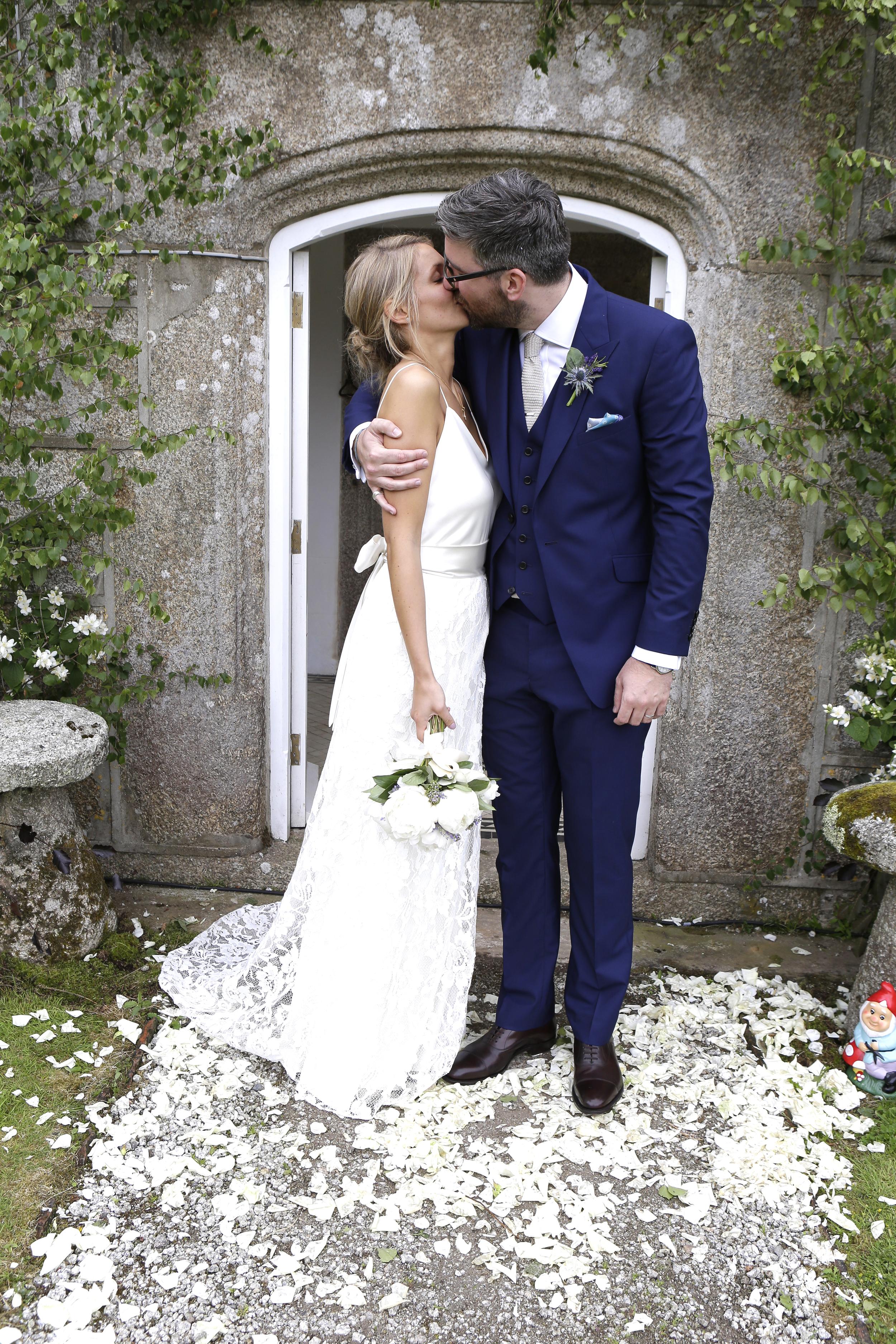 Beautiful bride Millie wears a wedding dress by Halfpenny London