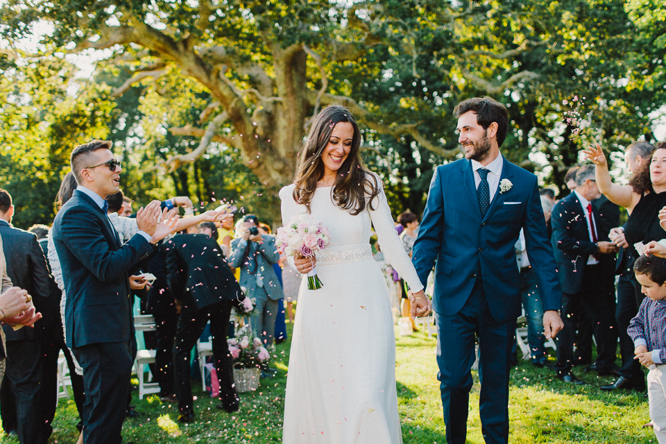 Gorgeous bride Andrea wore a bespoke wedding dress and veil by Halfpenny London