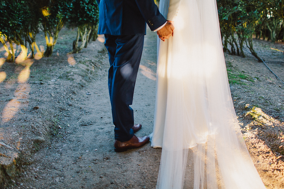 Beautiful bride Andrea wore a bespoke wedding dress and veil by Halfpenny London