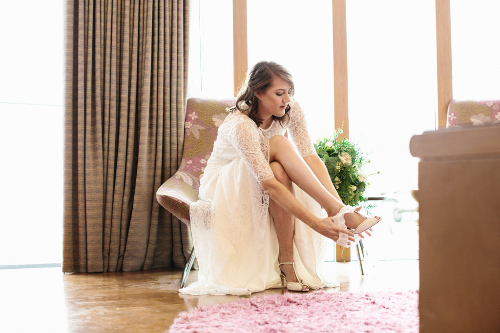Beautiful bride Becca wears a backless lave dress with sleeves by Halfpenny London