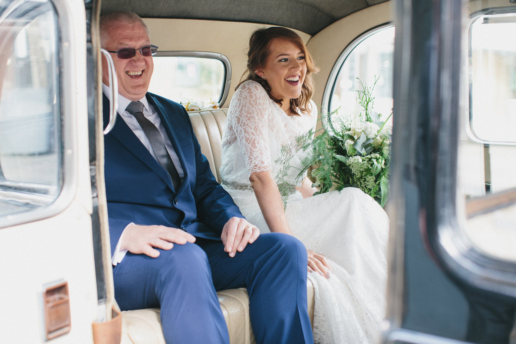 Beautiful bride Becca wears a backless lace dress with sleeves by Halfpenny London