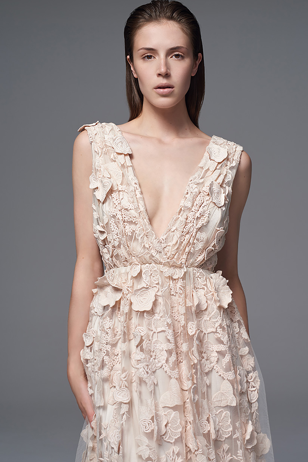 THE CLEMENCE FLORAL DRESS WITH PLUNGING V FRONT AND BACK COVERED IN 3D APPLIQUE FLOWERS. BRIDAL WEDDING DRESS BY HALFPENNY LONDON