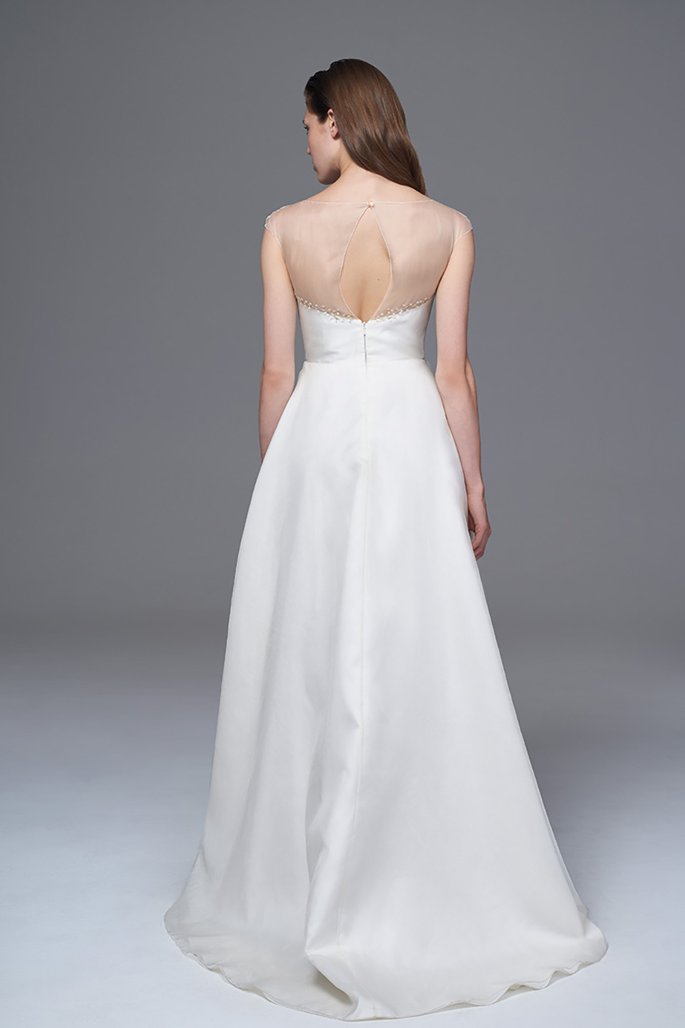 THE GRACE DRESS WITH AN ILLUSION AND HAND BEADED NECKLINE WITH A MIKARDO STRUCTURED SKIRT. BRIDAL WEDDING DRESS BY HALFPENNY LONDON