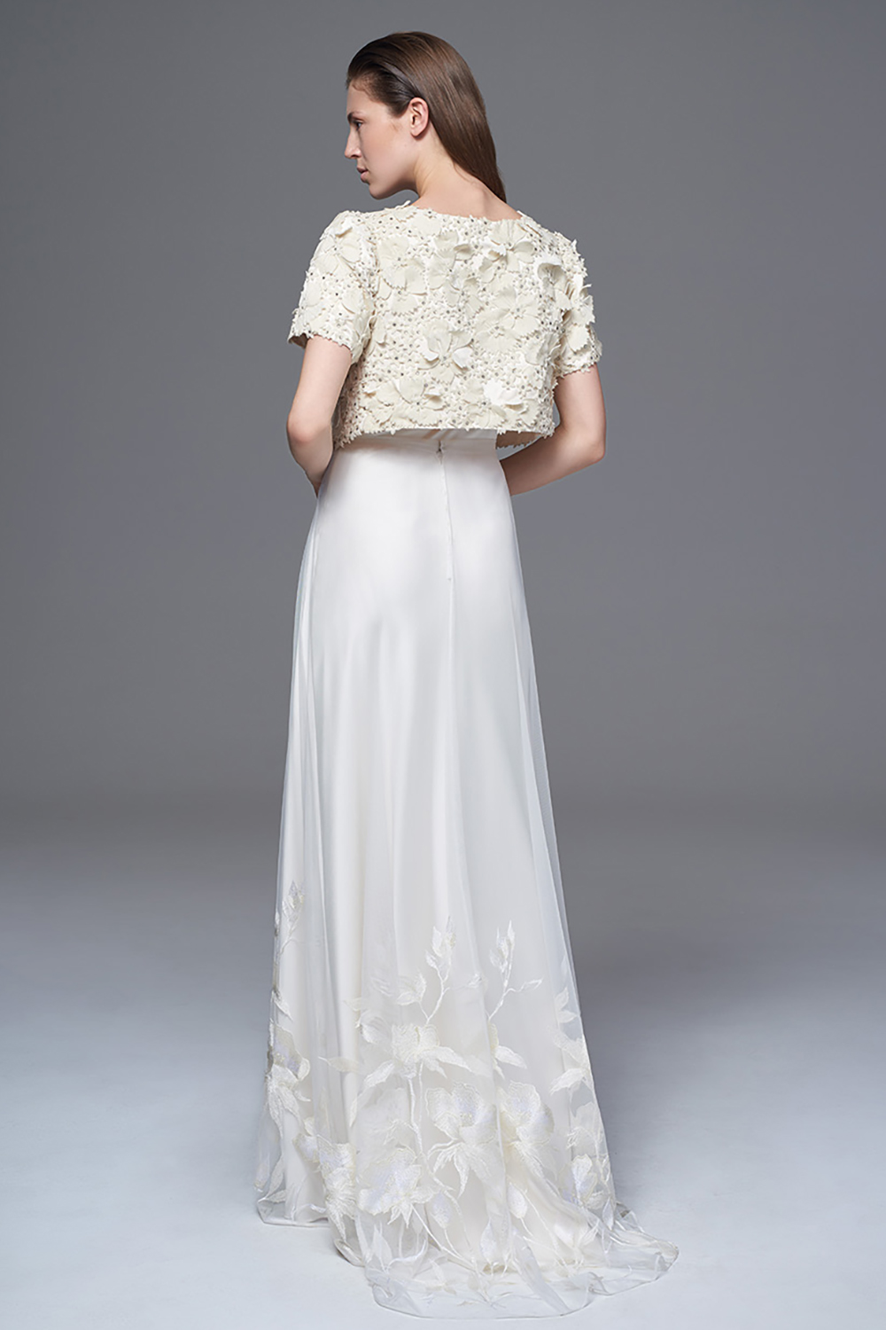 THE ISOBEL JACKET OF HAND CUT VELVET AND 3D FLOWERS WORN WITH THE SHEER TULLE AND EMBROIDERED LILY SKIRT AND CLASSIC IRIS SLIP. BRIDAL WEDDING DRESS BY HALFPENNY LONDON
