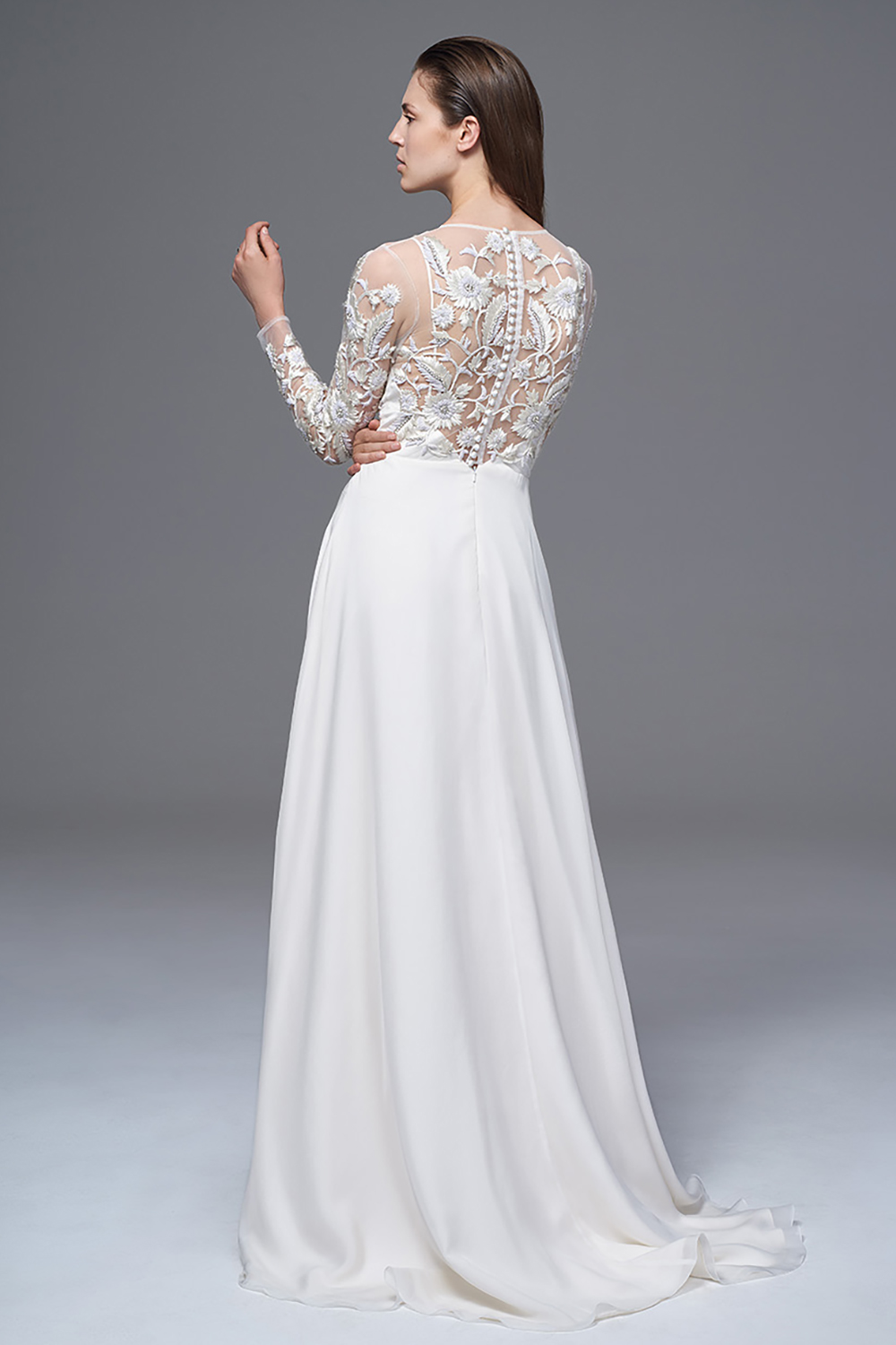 THE SYLVIE LONG SLEEVED DRESS WITH HAND CRAFTED 3D DIAMONTE AND EMBROIDERED BODICE WITH SATIN BUTTONS AND A SILK CHIFFON SKIRT. BRIDAL WEDDING DRESS BY HALFPENNY LONDON