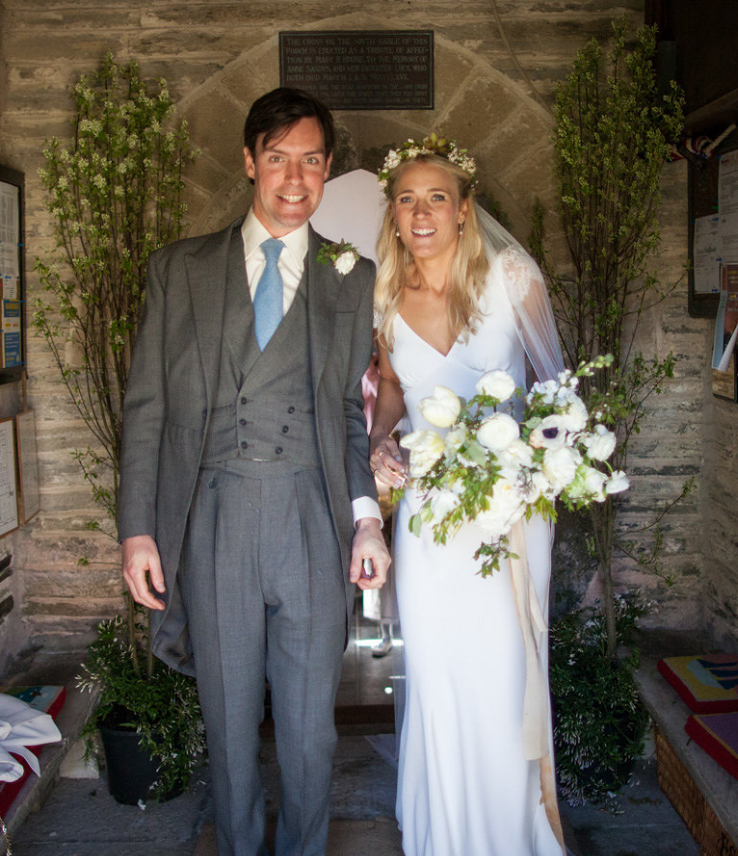 Carly wears a wedding dress by Halfpenny London